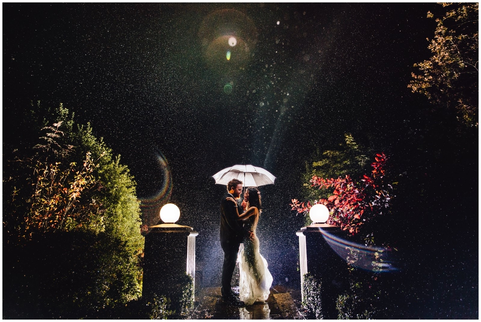 Back lit rain wedding photography