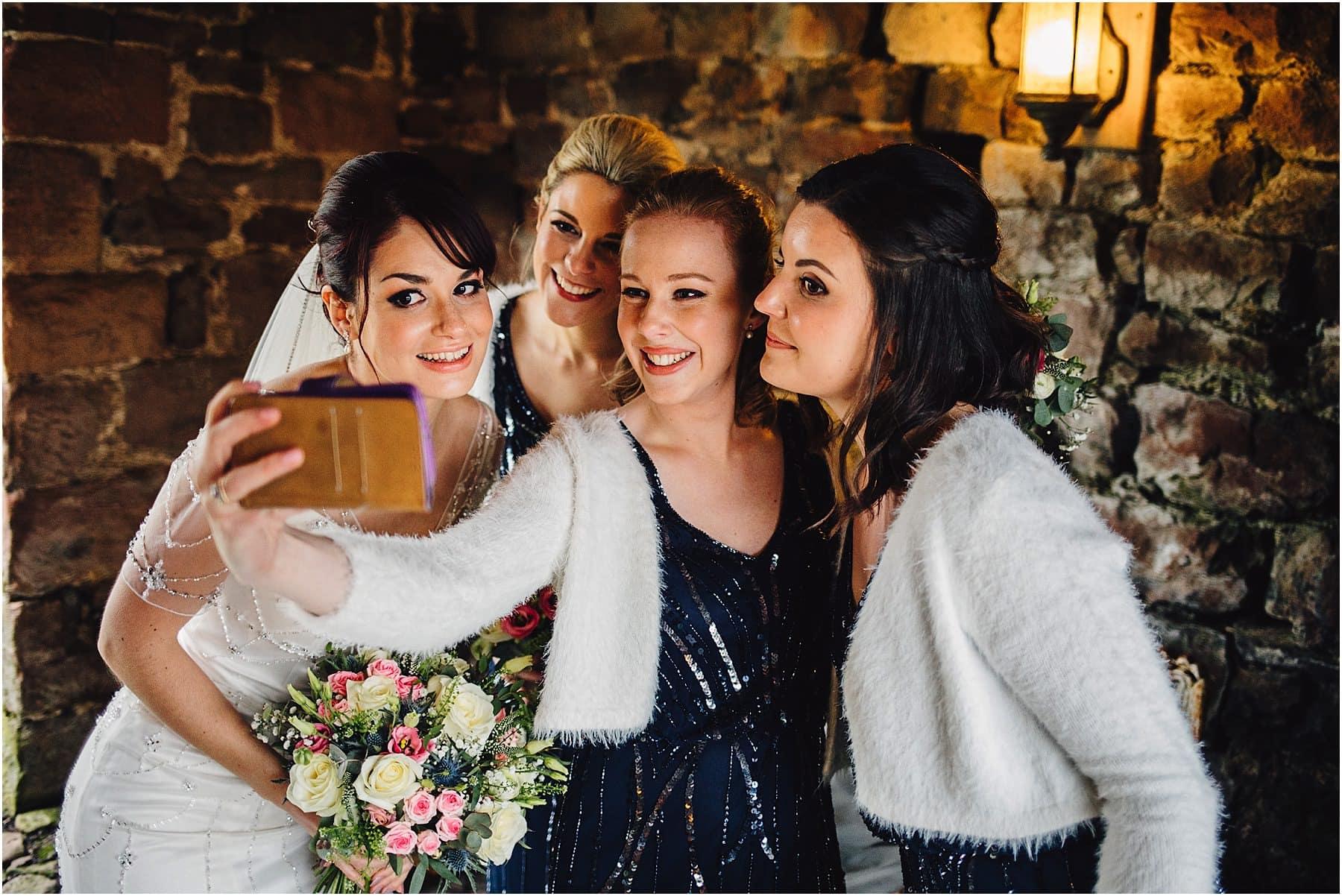 Bride & Bridesmaids taking a selfie