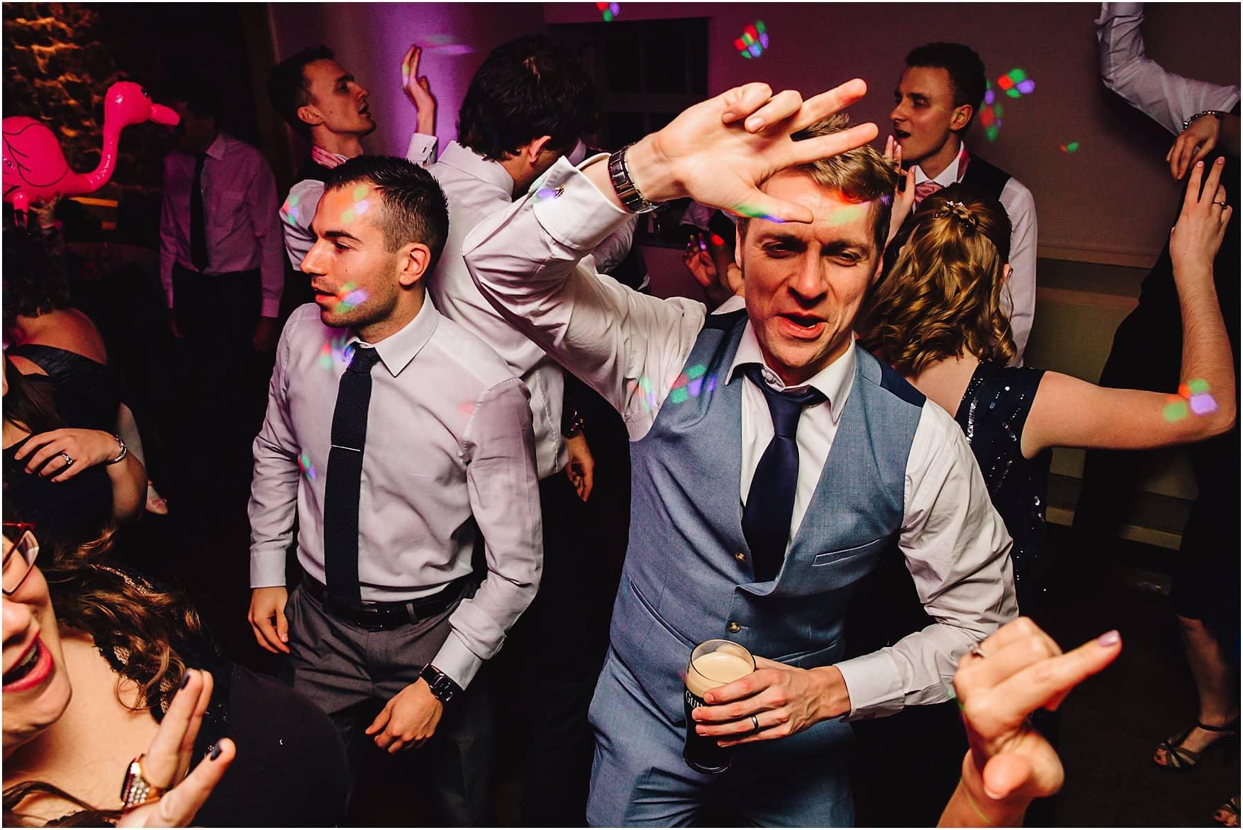Best man dancing at a wedding