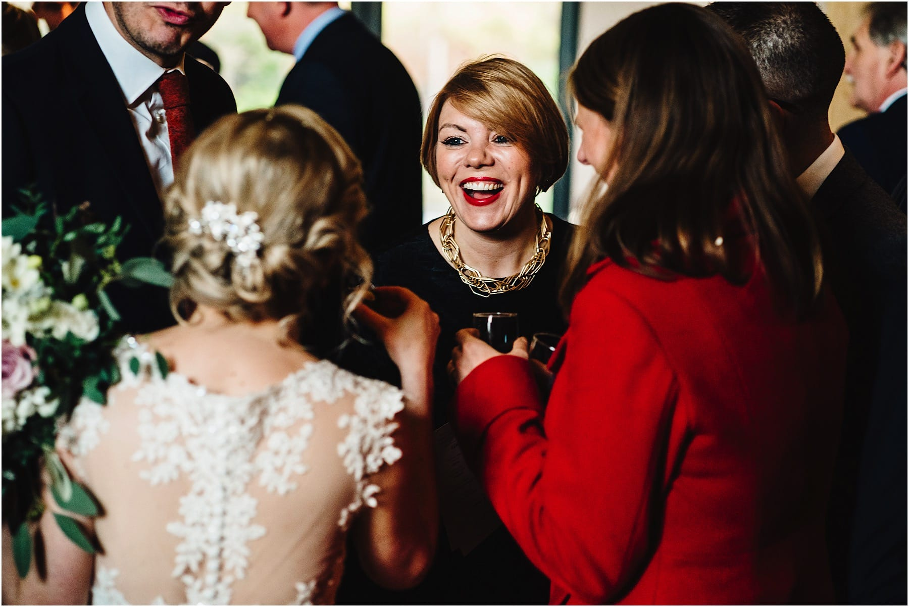 wedding guest laughing during drinks reception