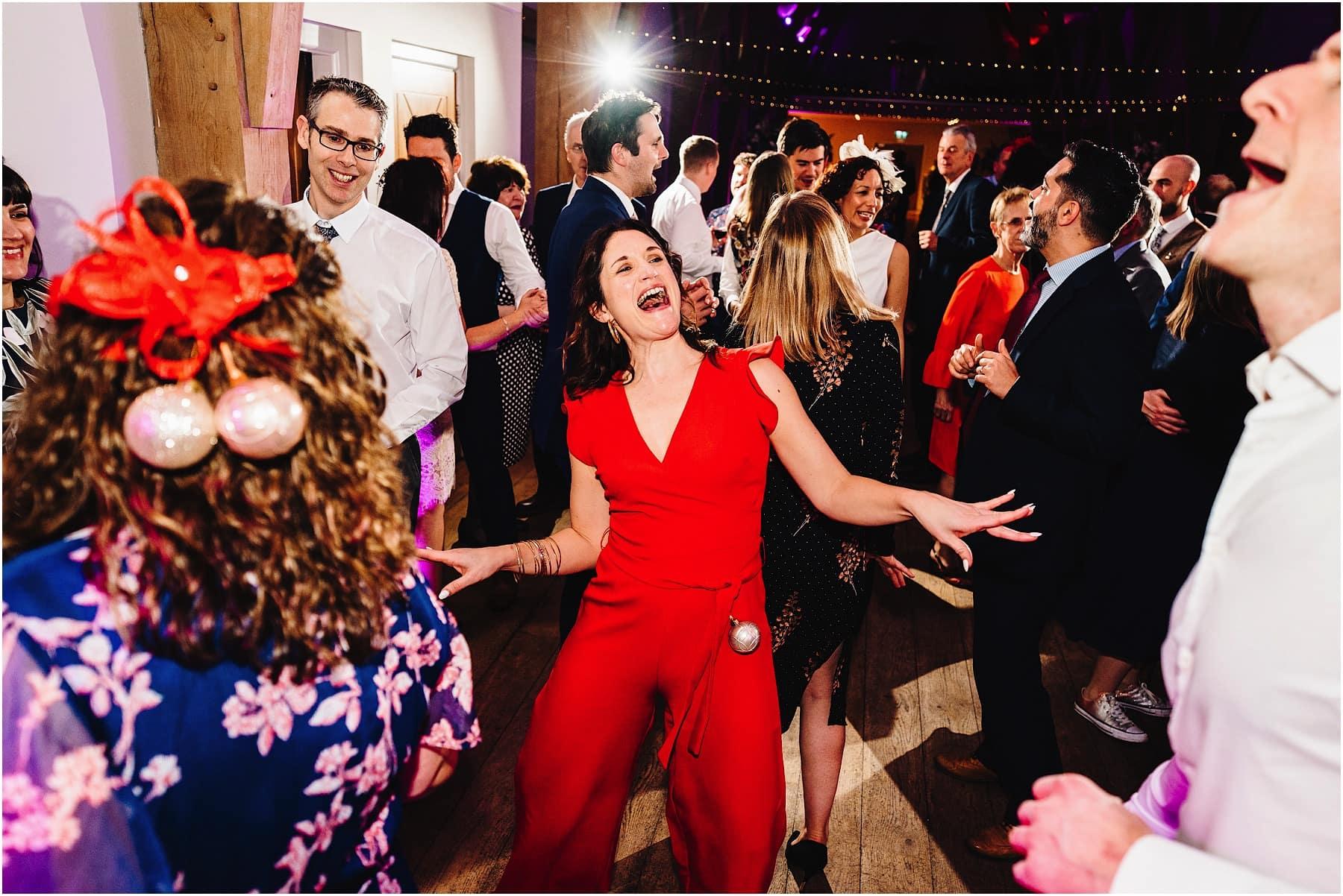 wedding guest dancing on the dance floor at Mill Barns wedding venue