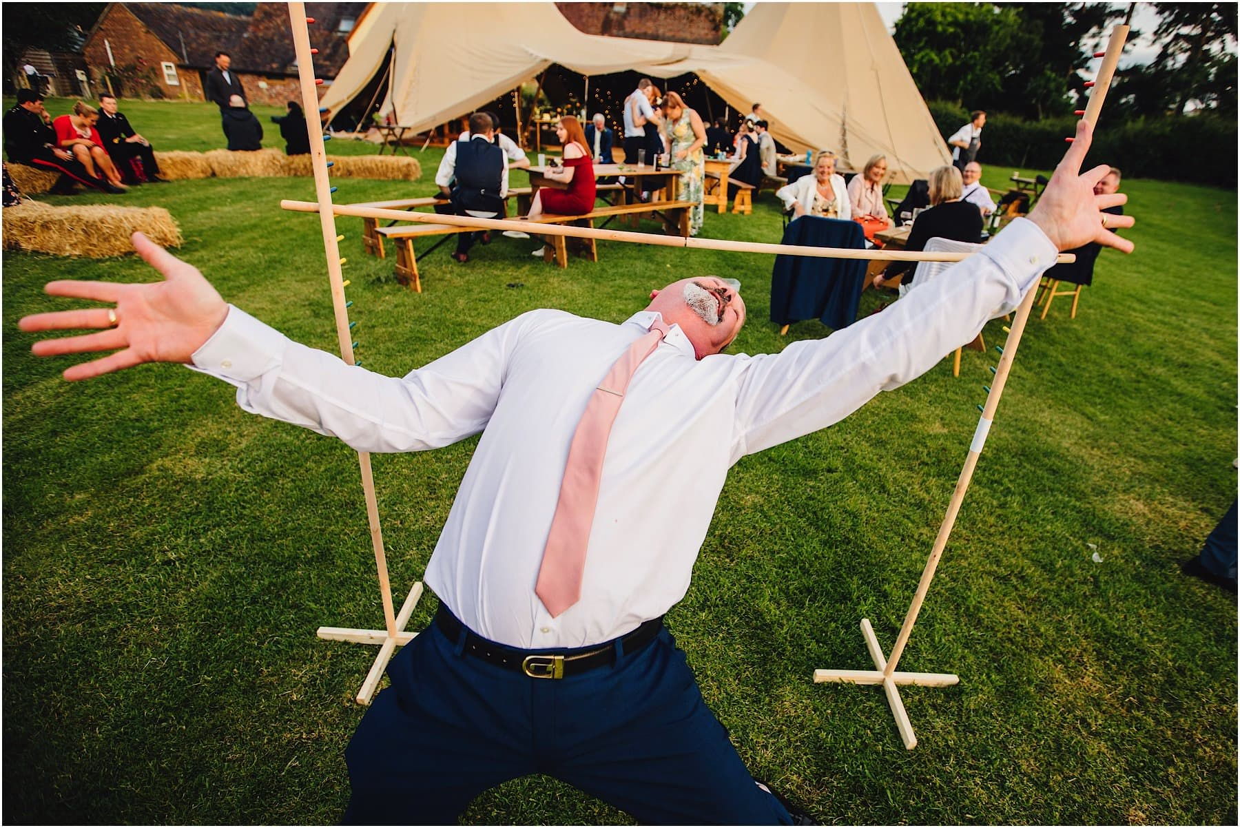 Fun limbo at the Haybarn Wedding Venue