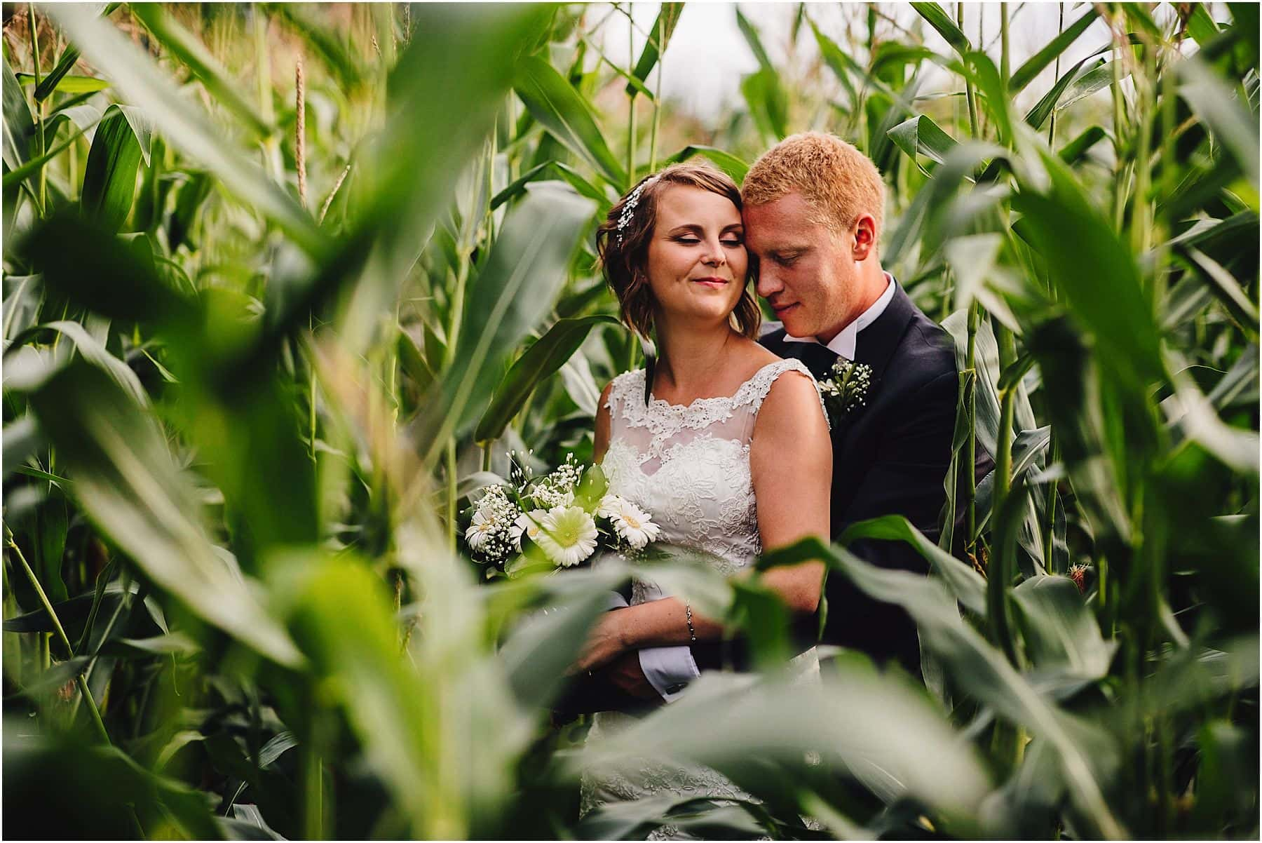Couple in farmers field near Mythe Barn