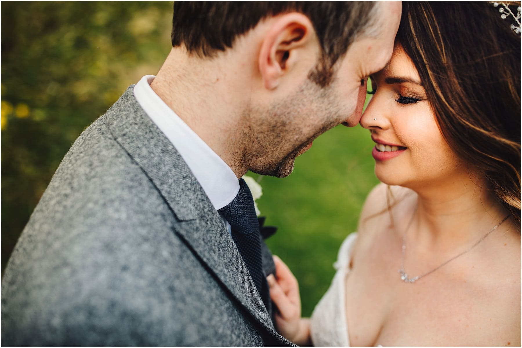 bride and groom embracing at Mythe Barn