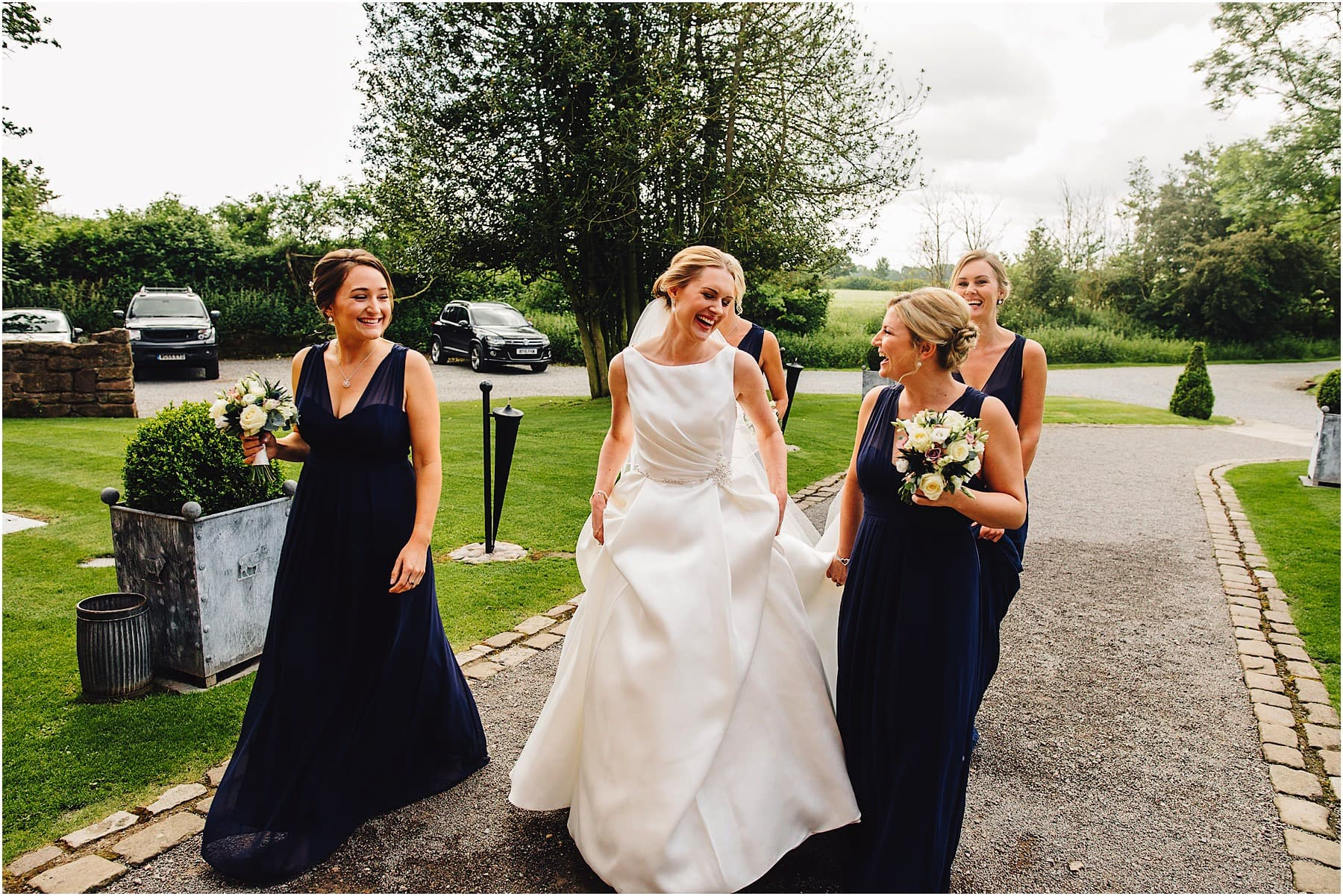 bride and bridesmaids entering Shustoke Barn