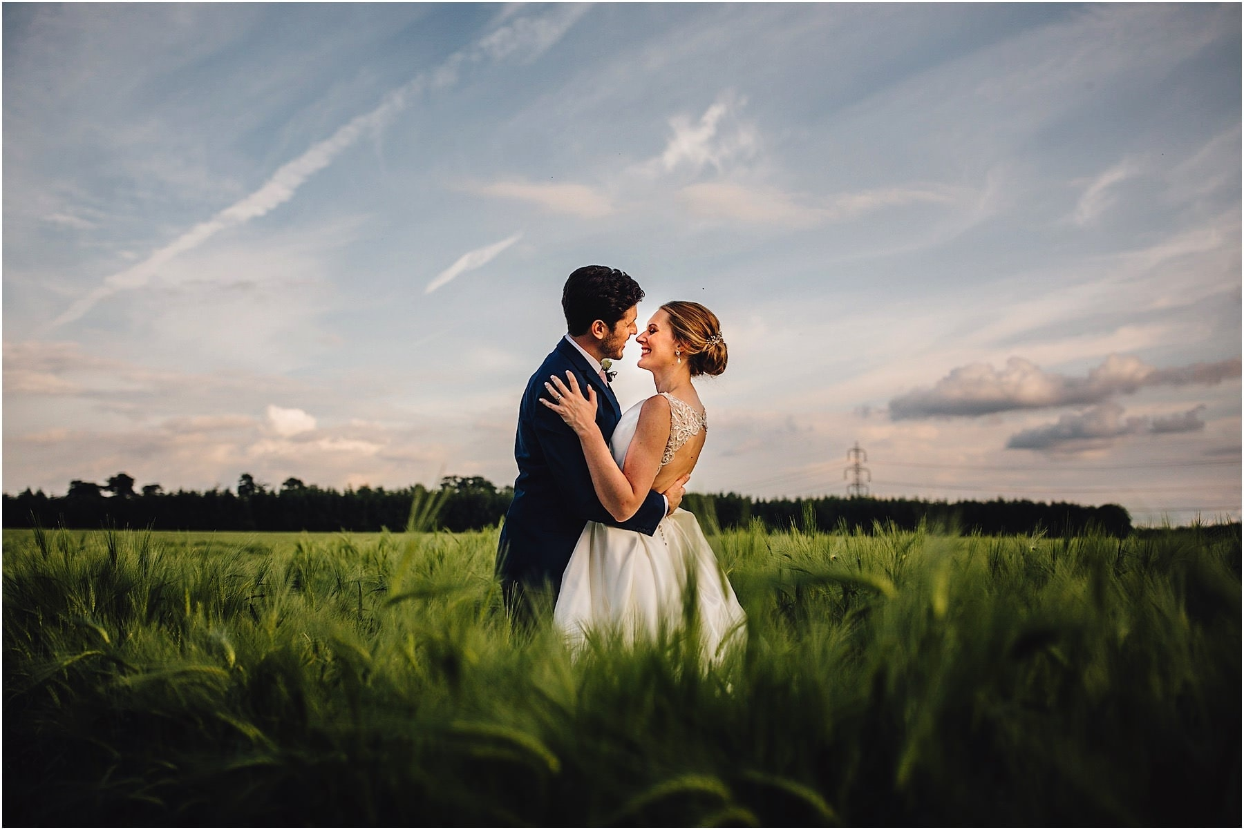 couple kissing in the fields of Shustoke