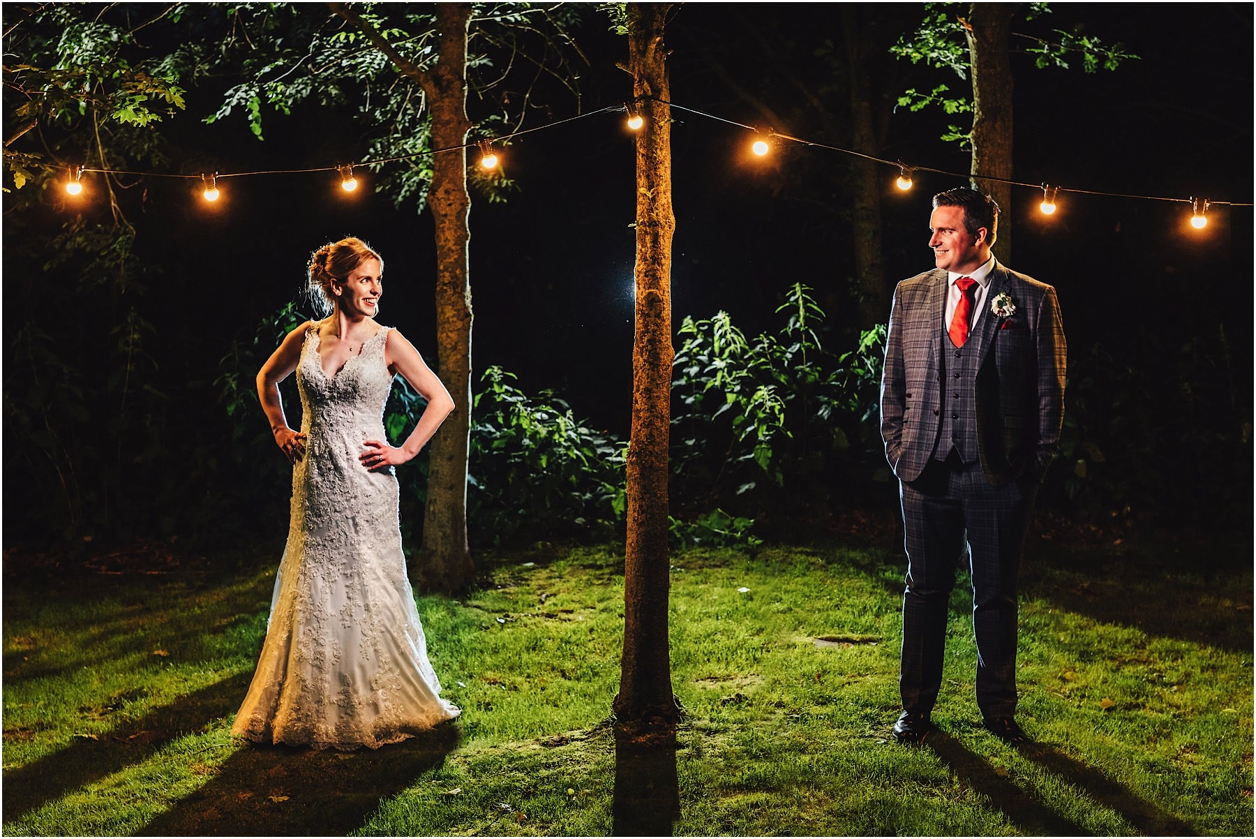 bride and groom in the festoon lights