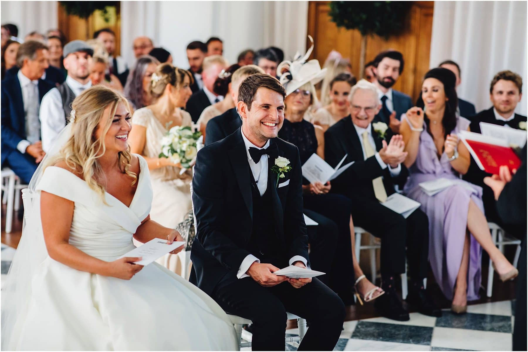 bride and groom laughing at celebrant