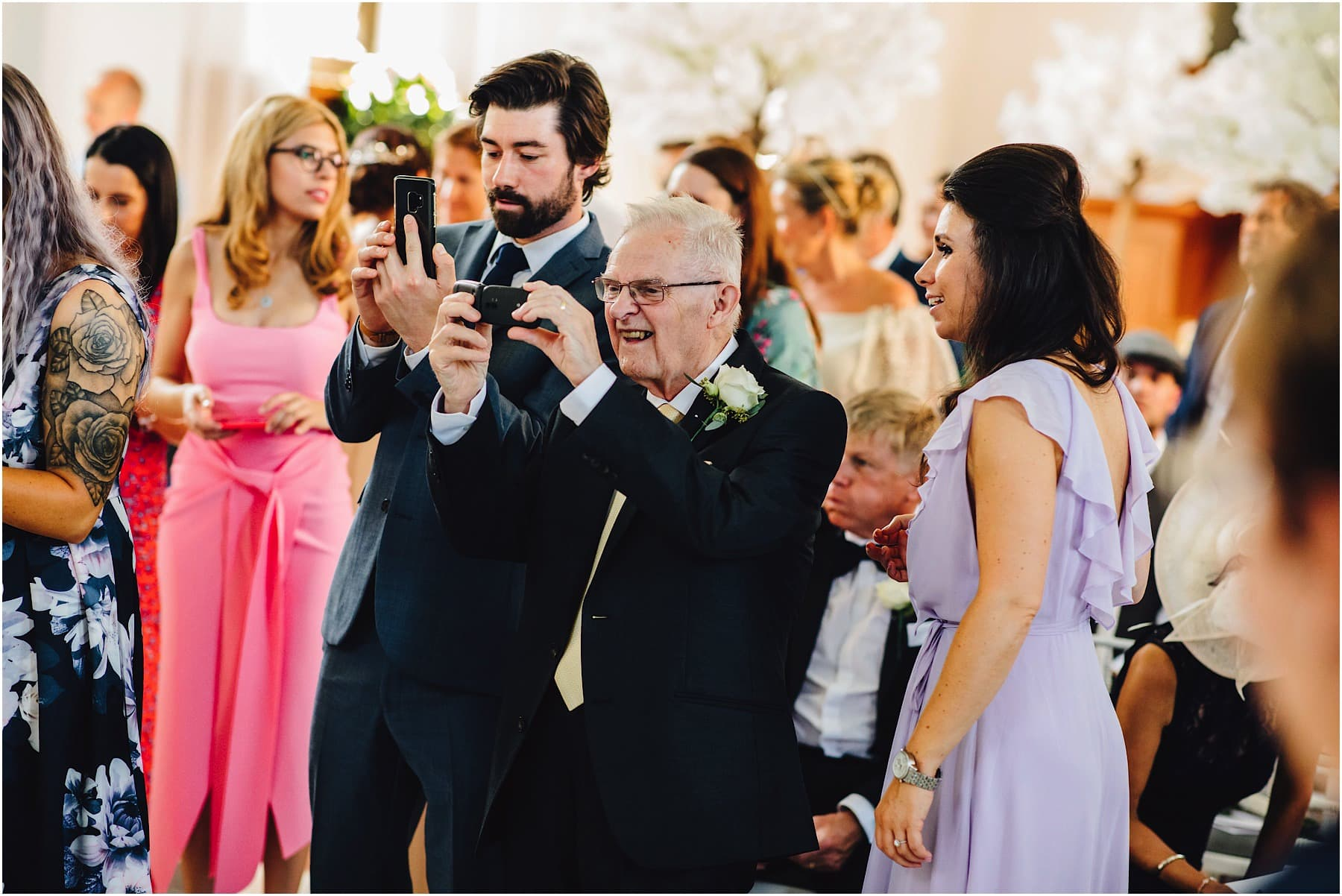 grandfather of the bride taking a picture