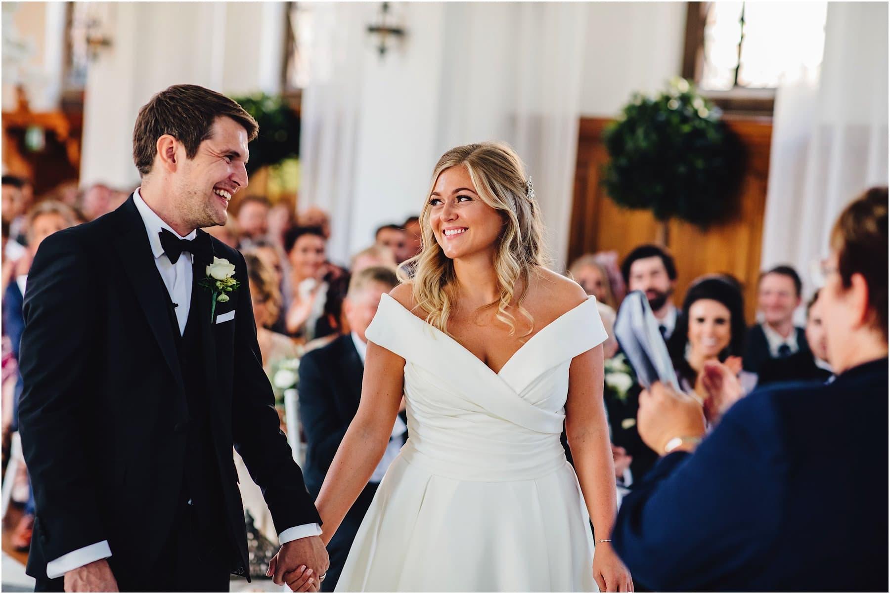 bride and groom happy at wedding ceremony