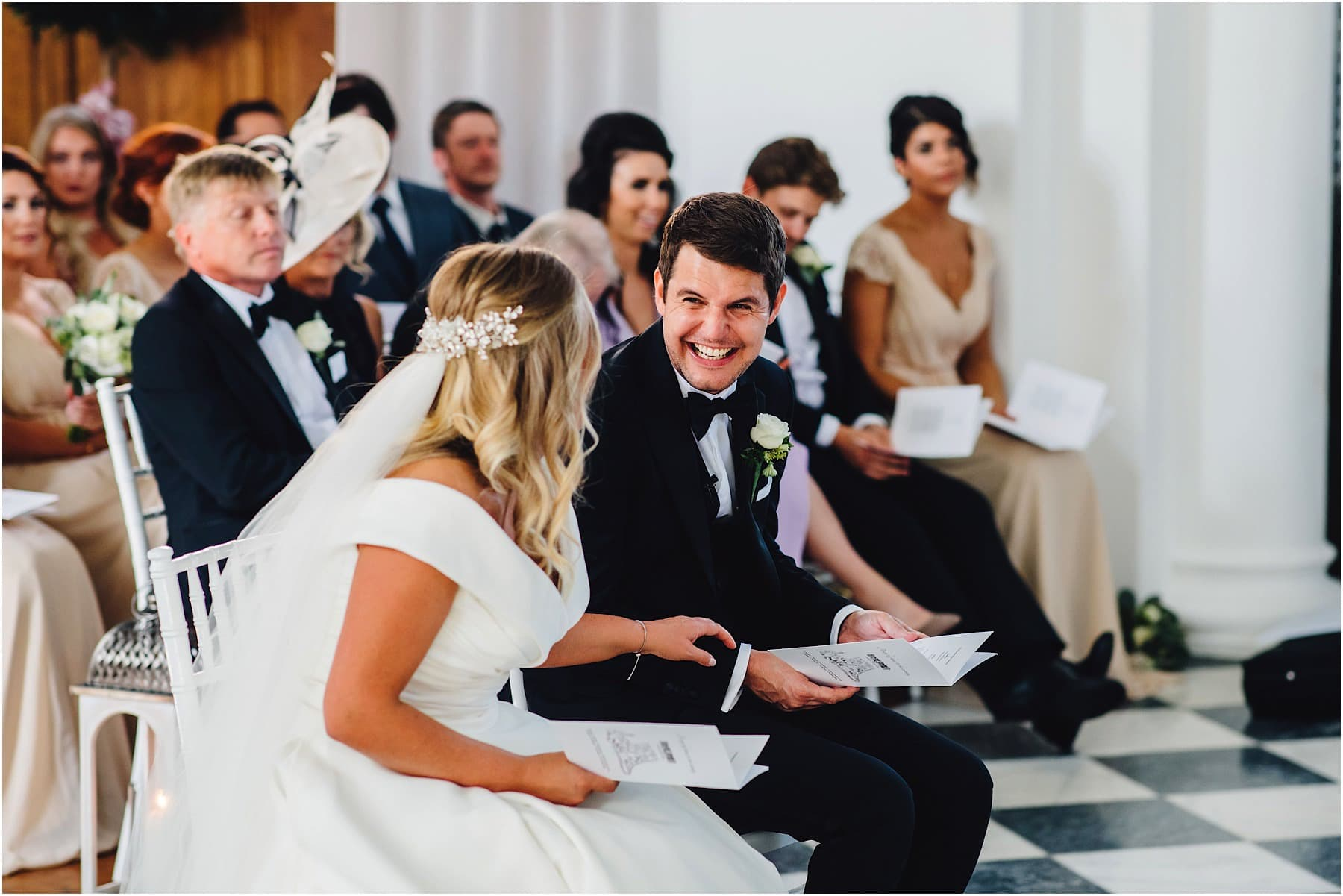 groom bursting into laughter at his bride