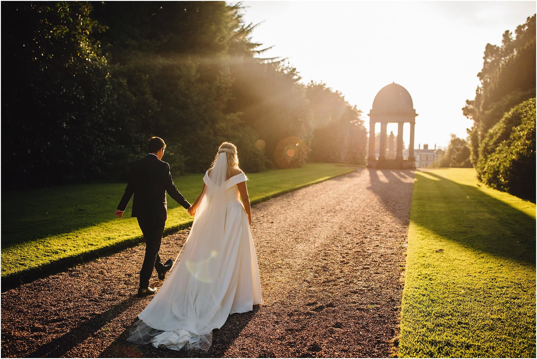Bride and groom walking in to the sunset