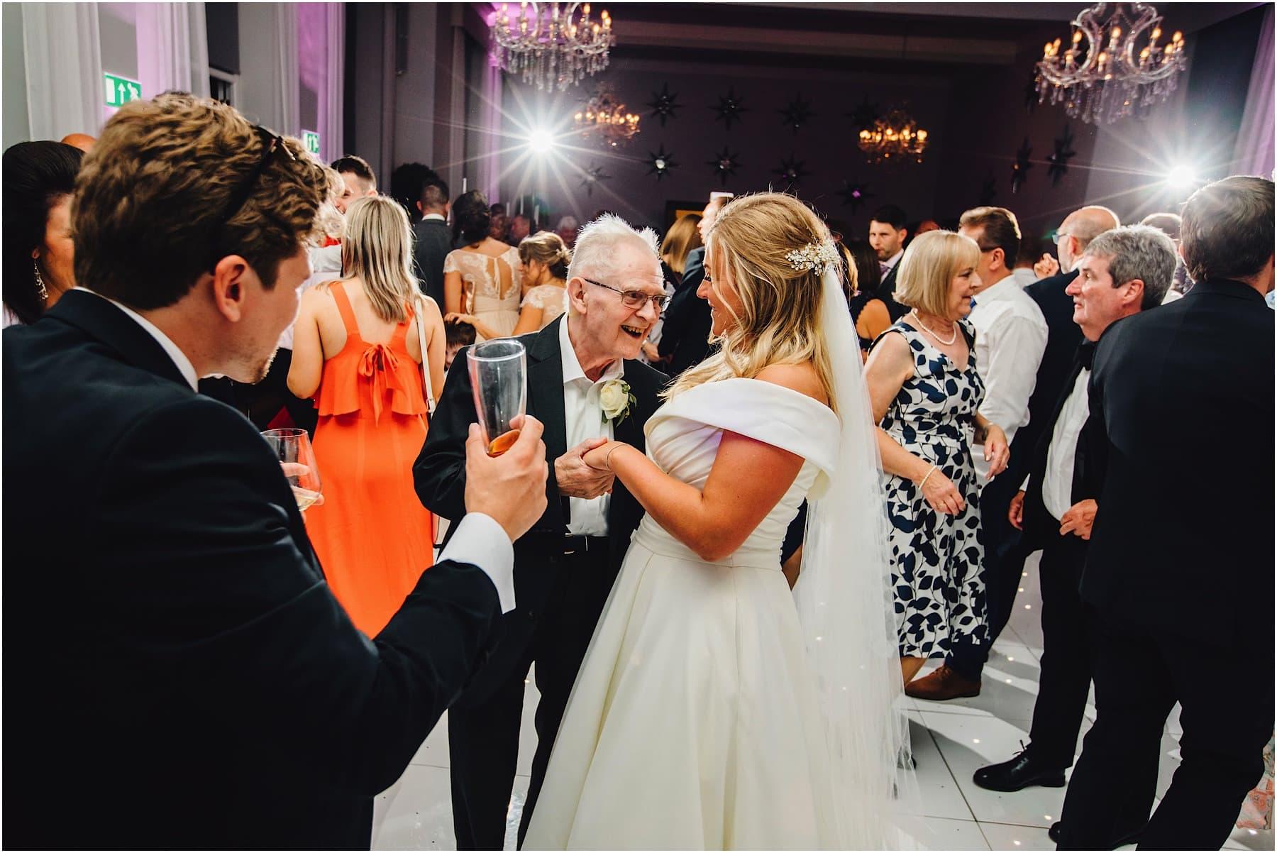 brides grandad dancing with bride
