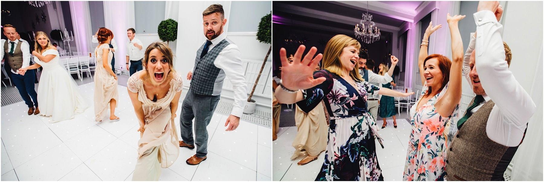 lots of wedding guests dancing