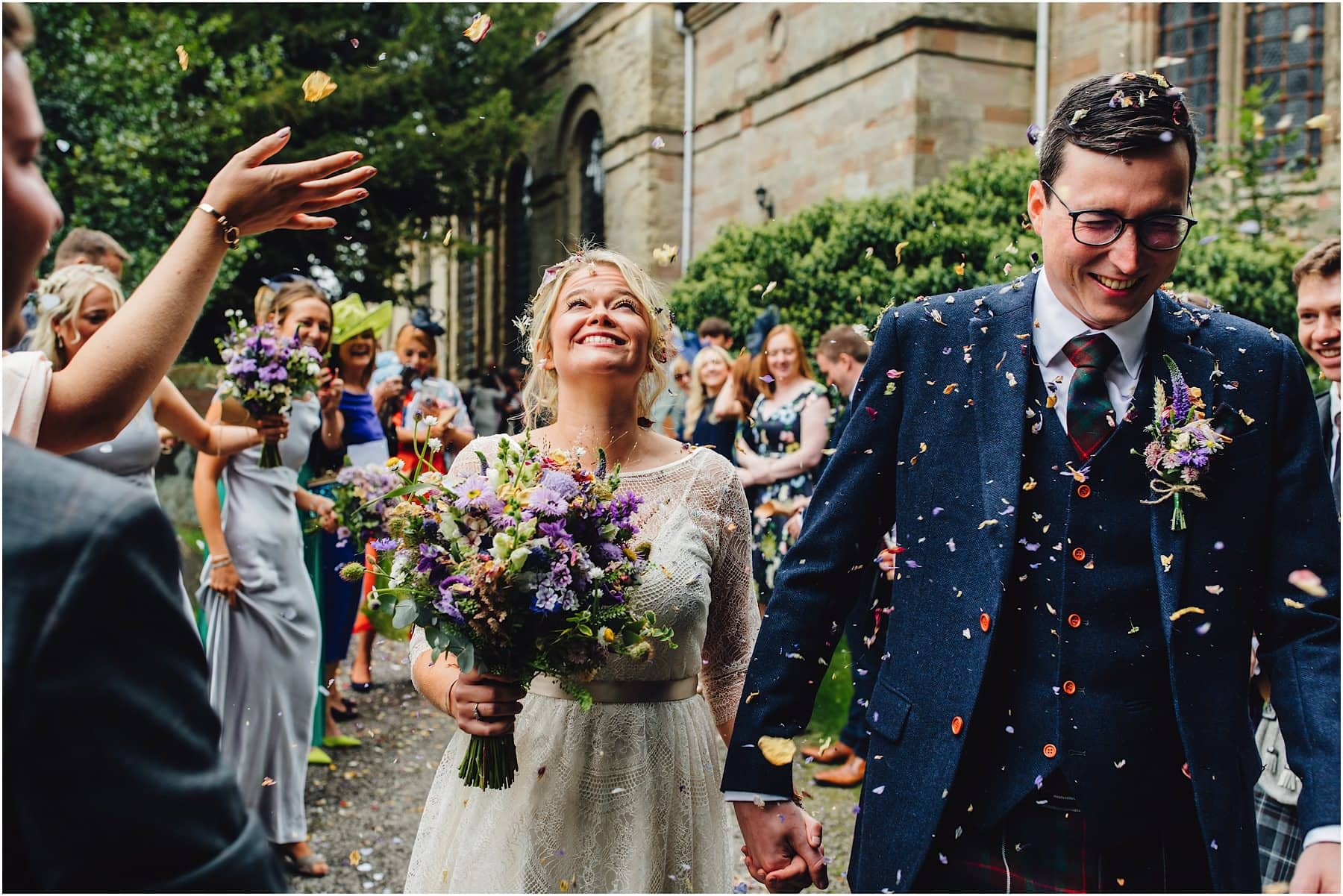 throwing confetti at bride and groom in Worcestershire