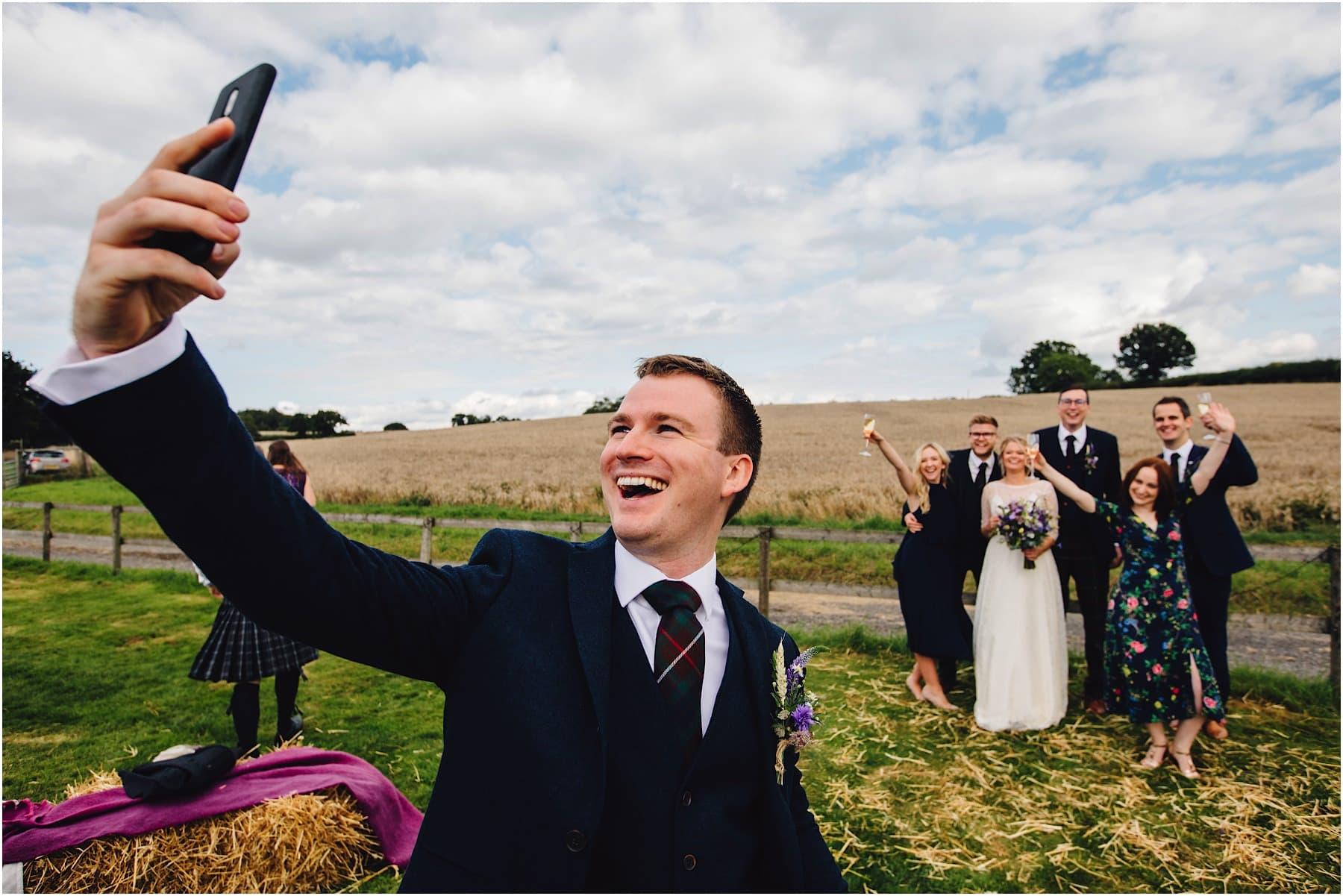 best man doing a selfie