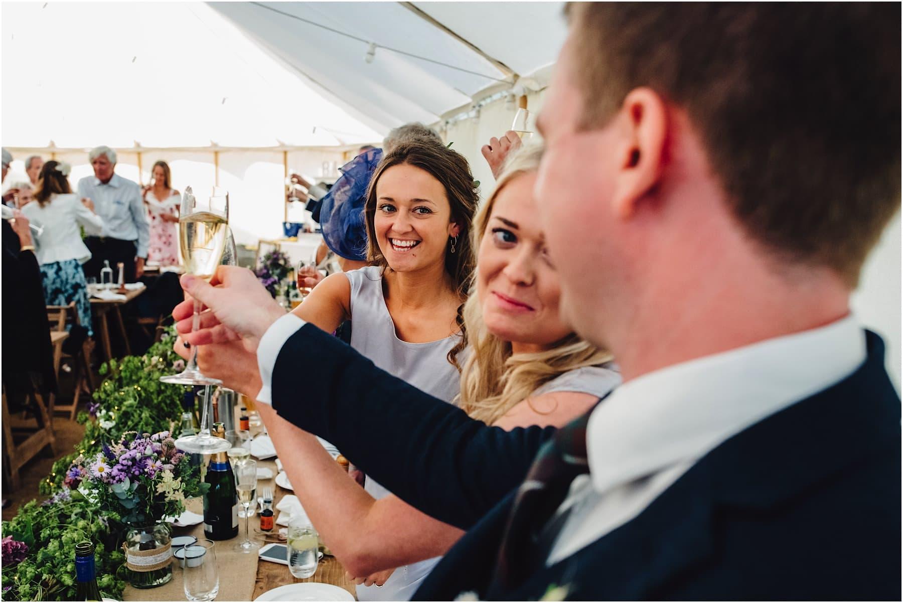 bridesmaids raising a toast