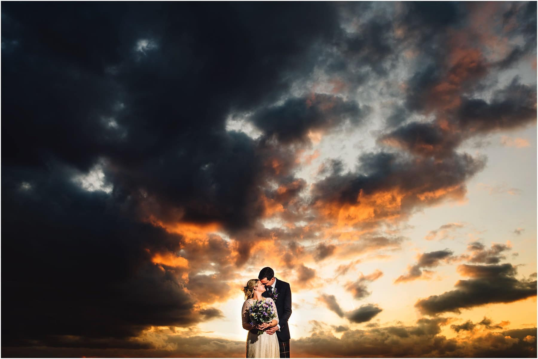 bride and groom in a sunset