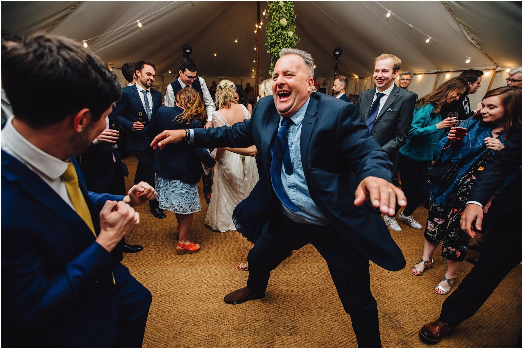 wedding guest pulling crazy dance moves