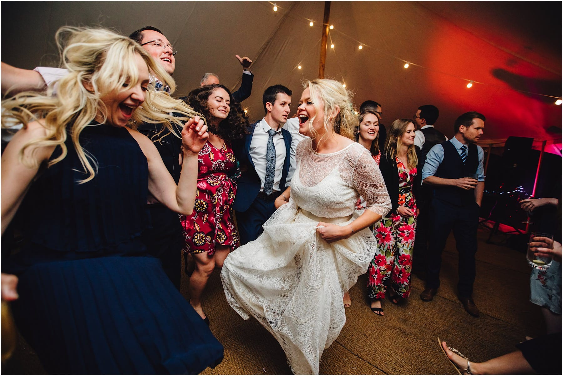 bride lifter her dress whilst dancing