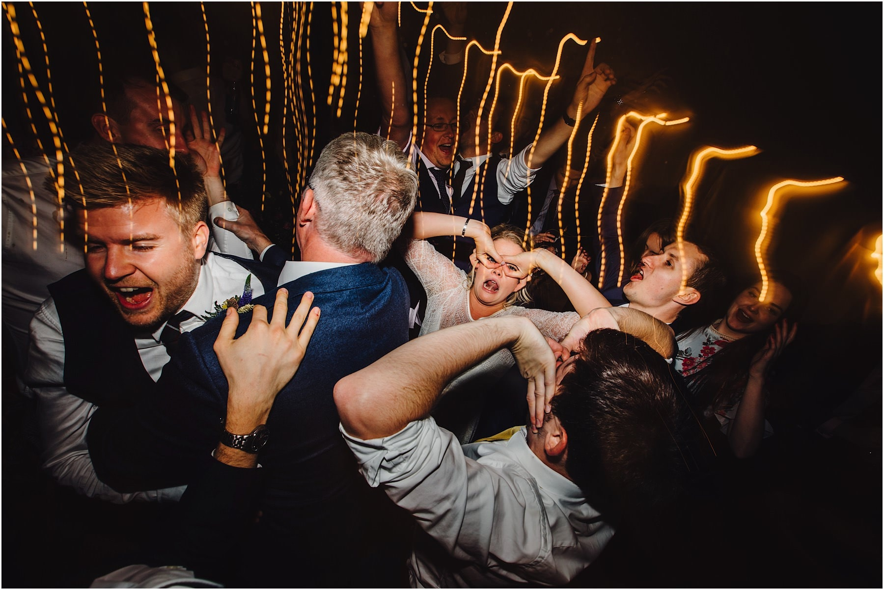 bride pulling faces on the dance floor