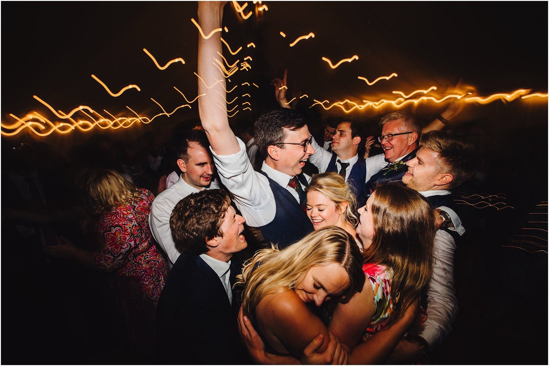 bride and groom surrounded on dance floor