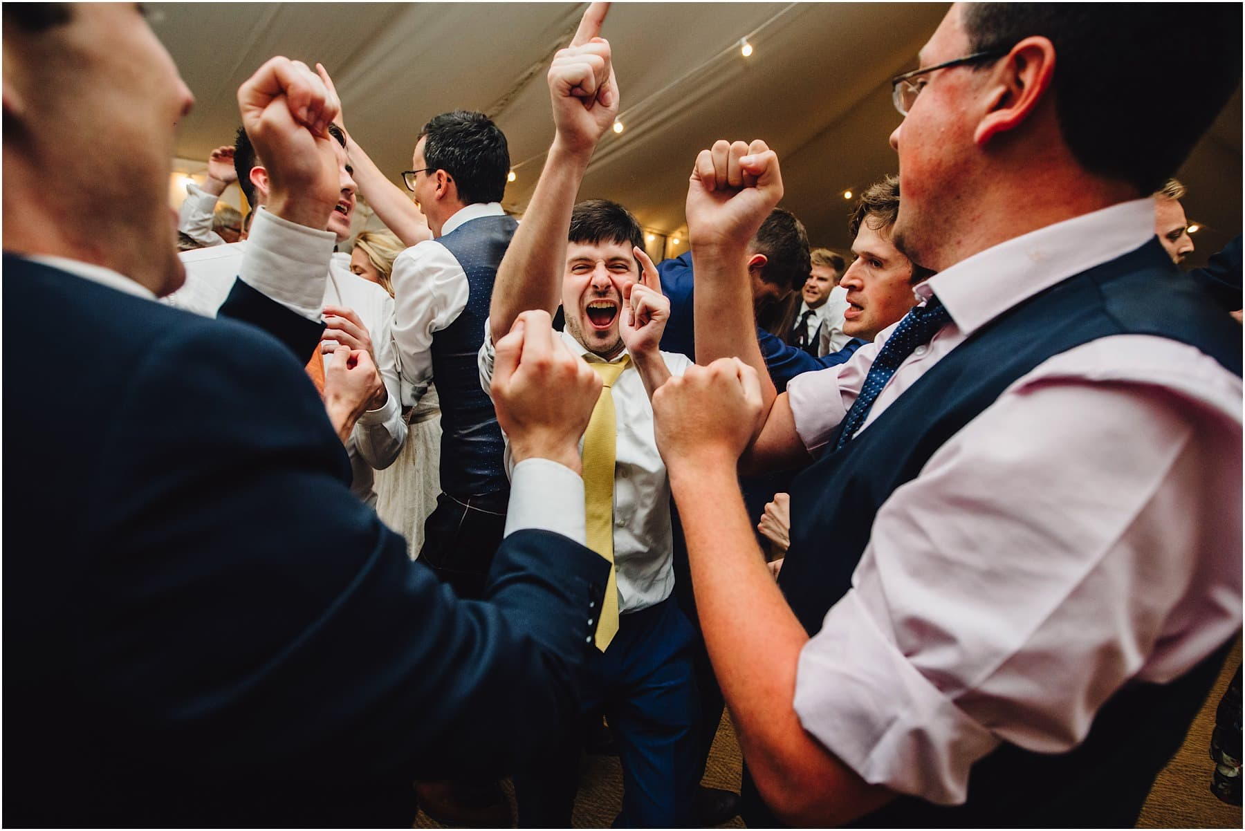 wedding guests pointing fingers