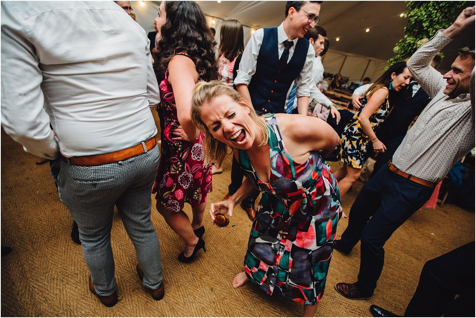 wedding guest bent over on the dance floor