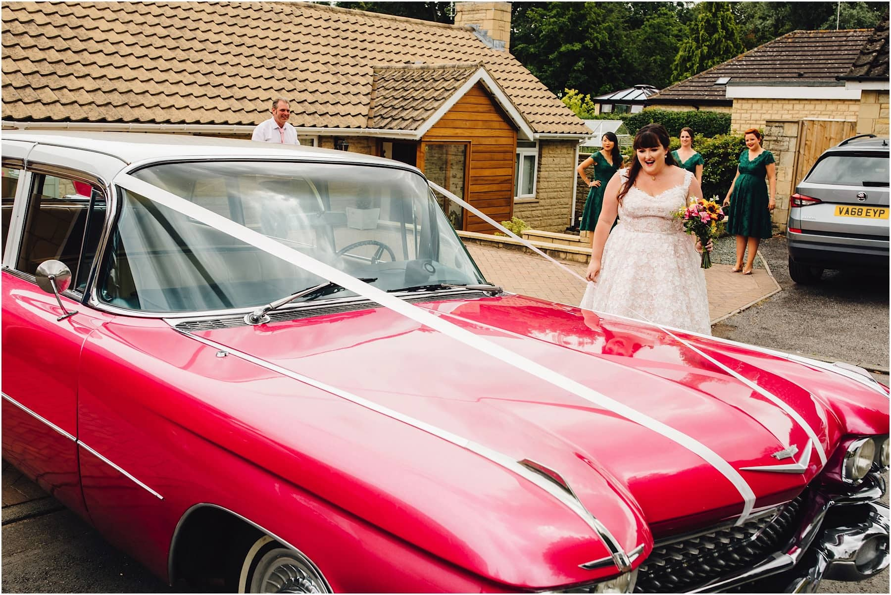 bride reacts to her big pink wedding car