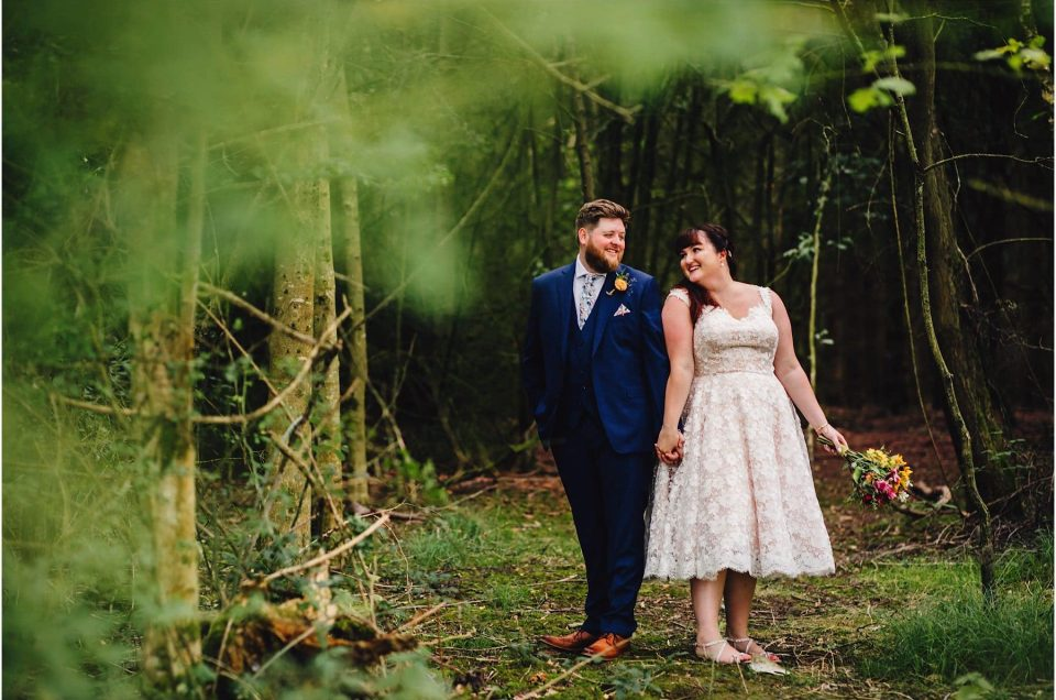 bride and groom posing in the trees