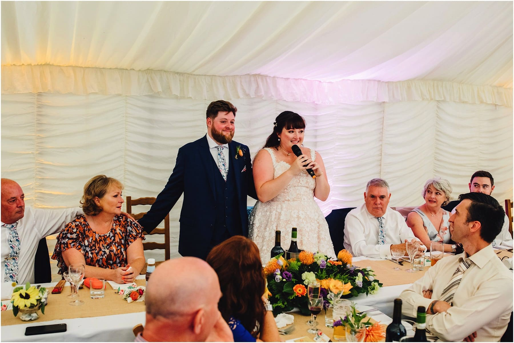bride and groom delivering their wedding speech