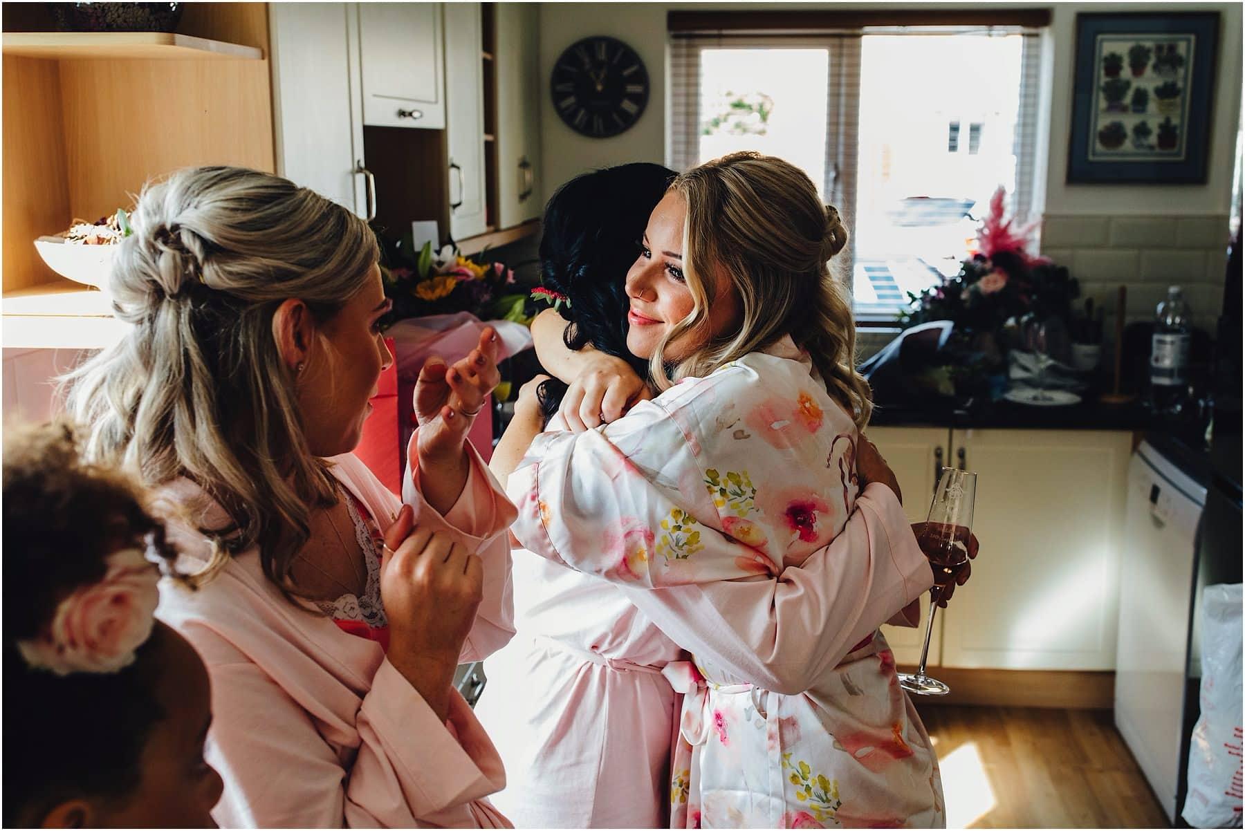 bridal party hugging