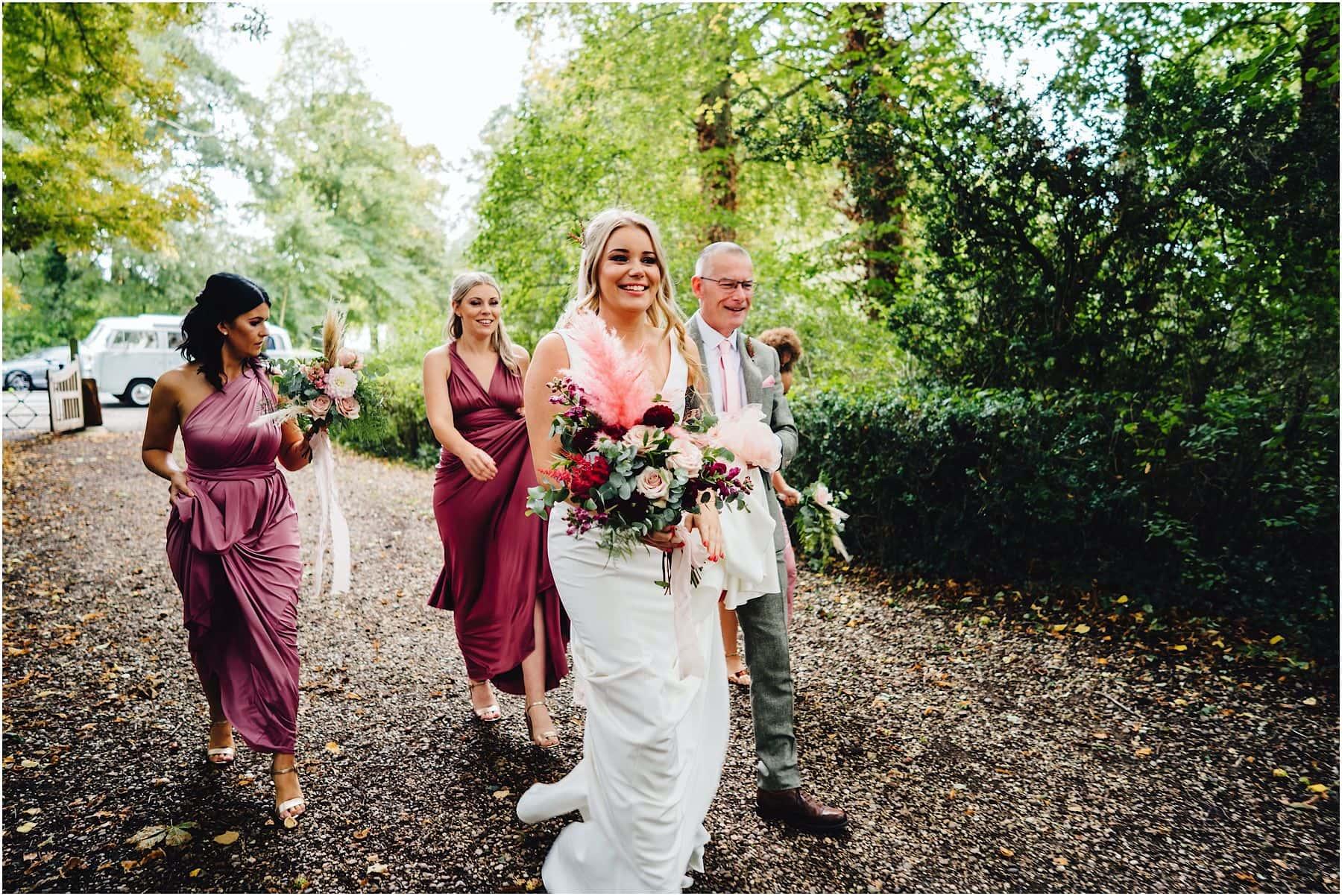 bride walking towards church