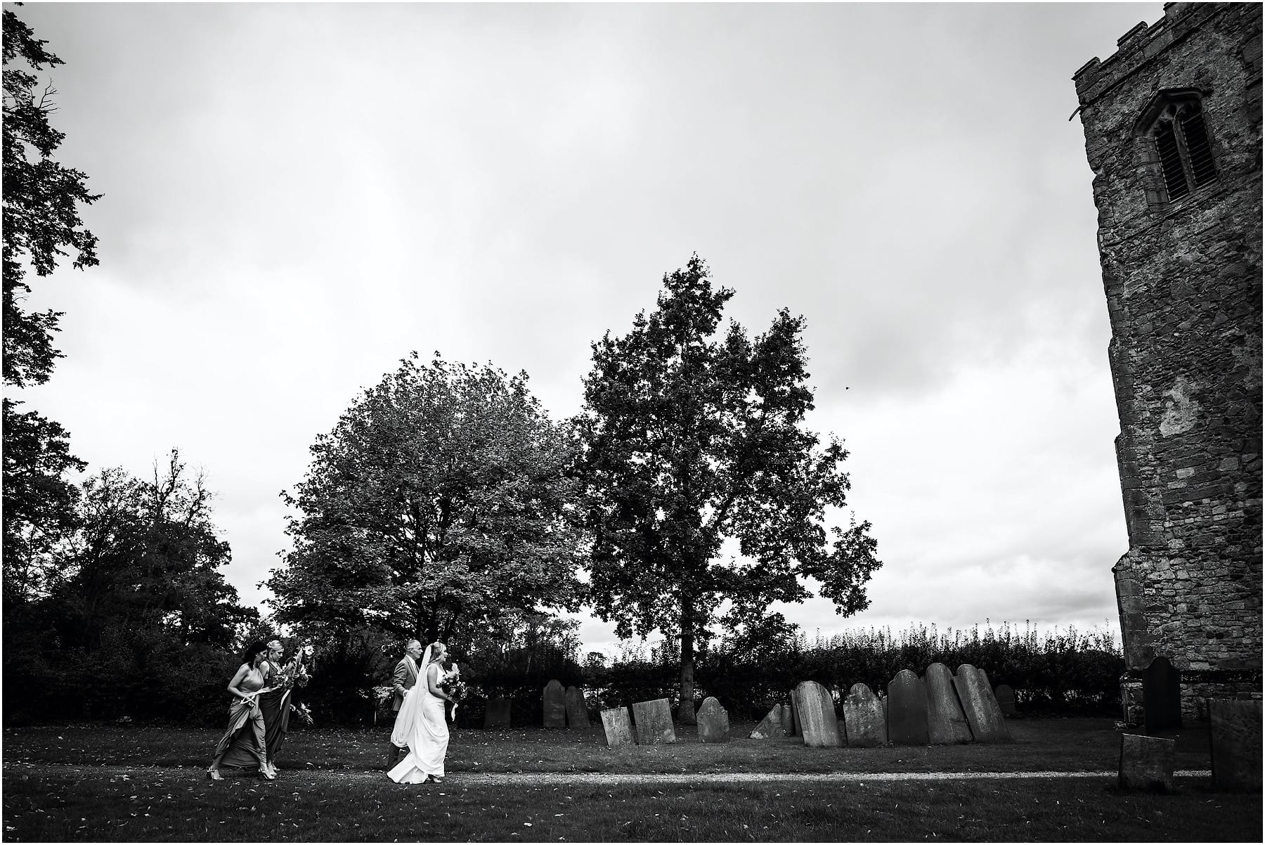 bridal party crossing the church grounds