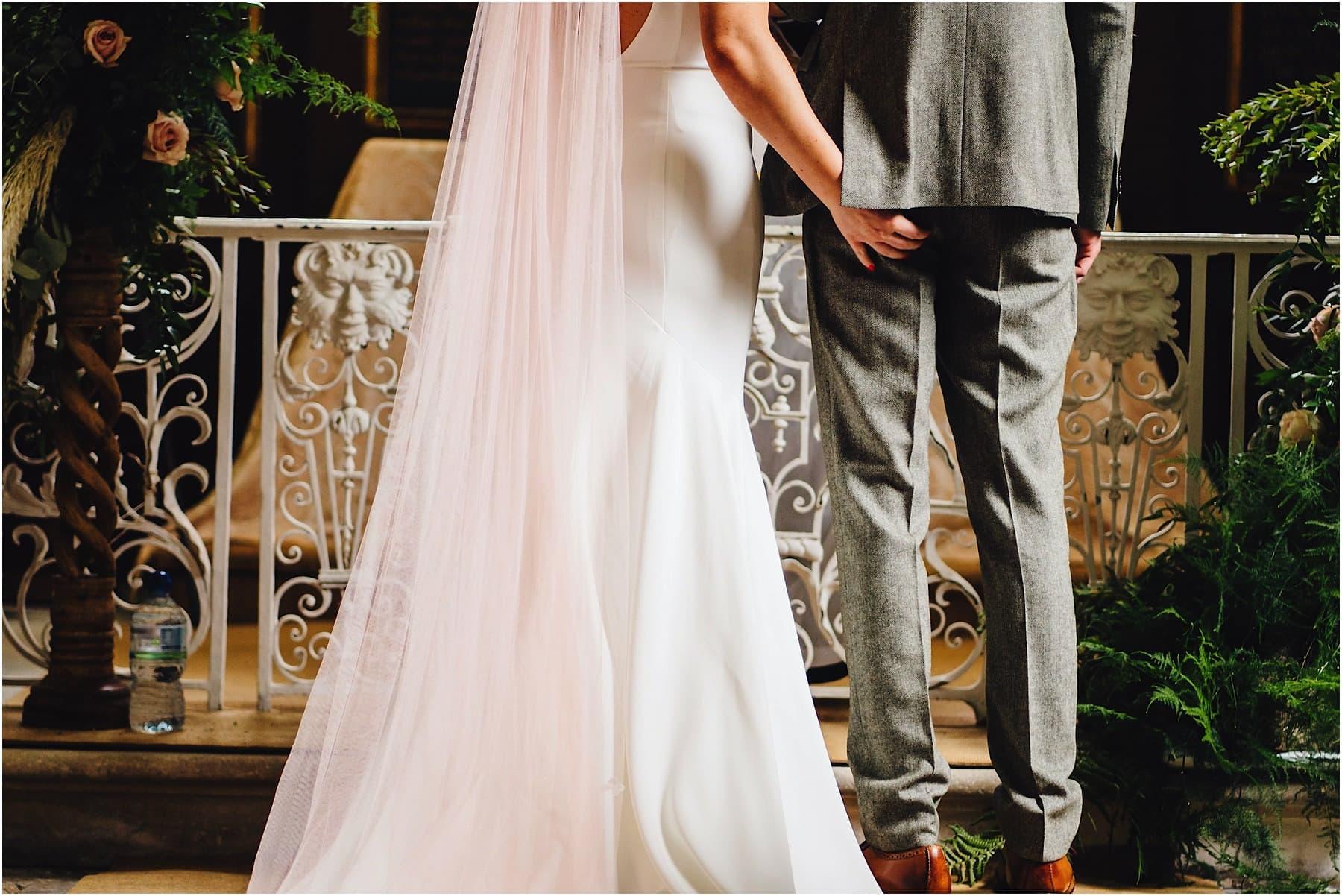 bride grabbing groom