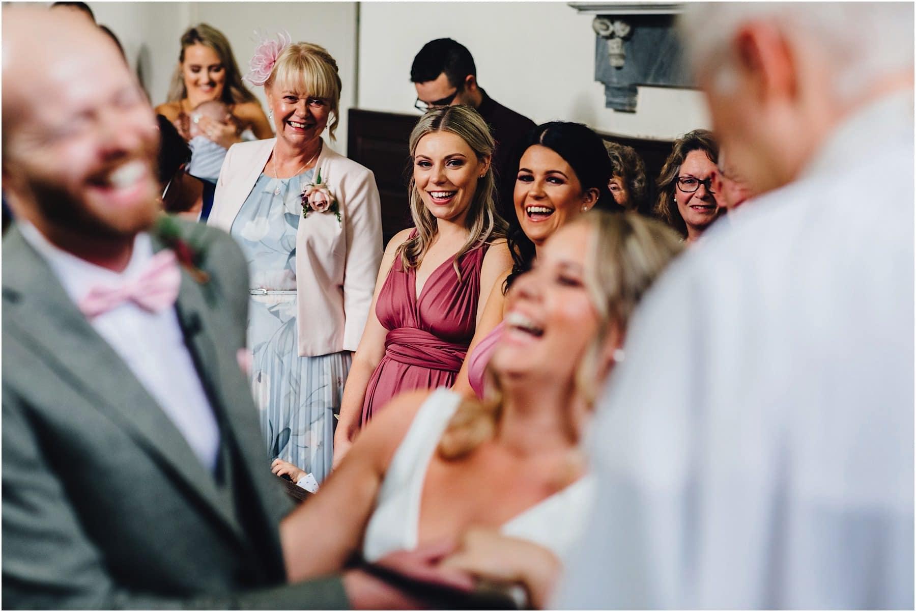 bridesmaids smiling at wedding service