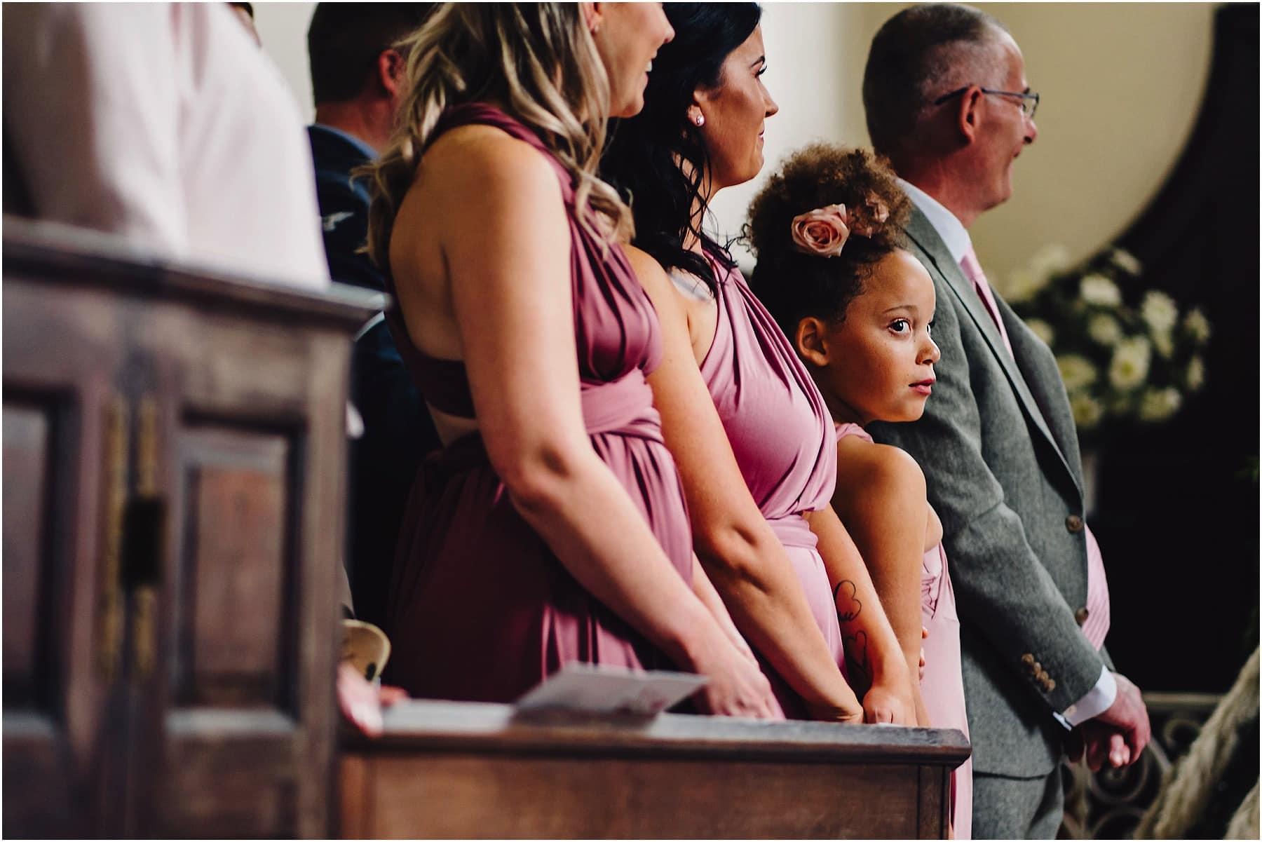 bridesmaid looking around the church