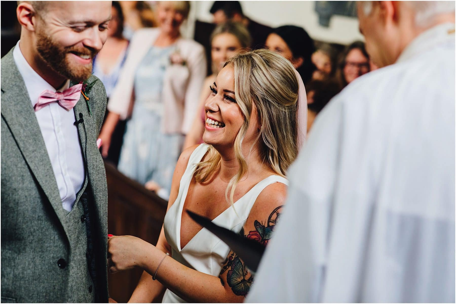 bride belly laughing during wedding service