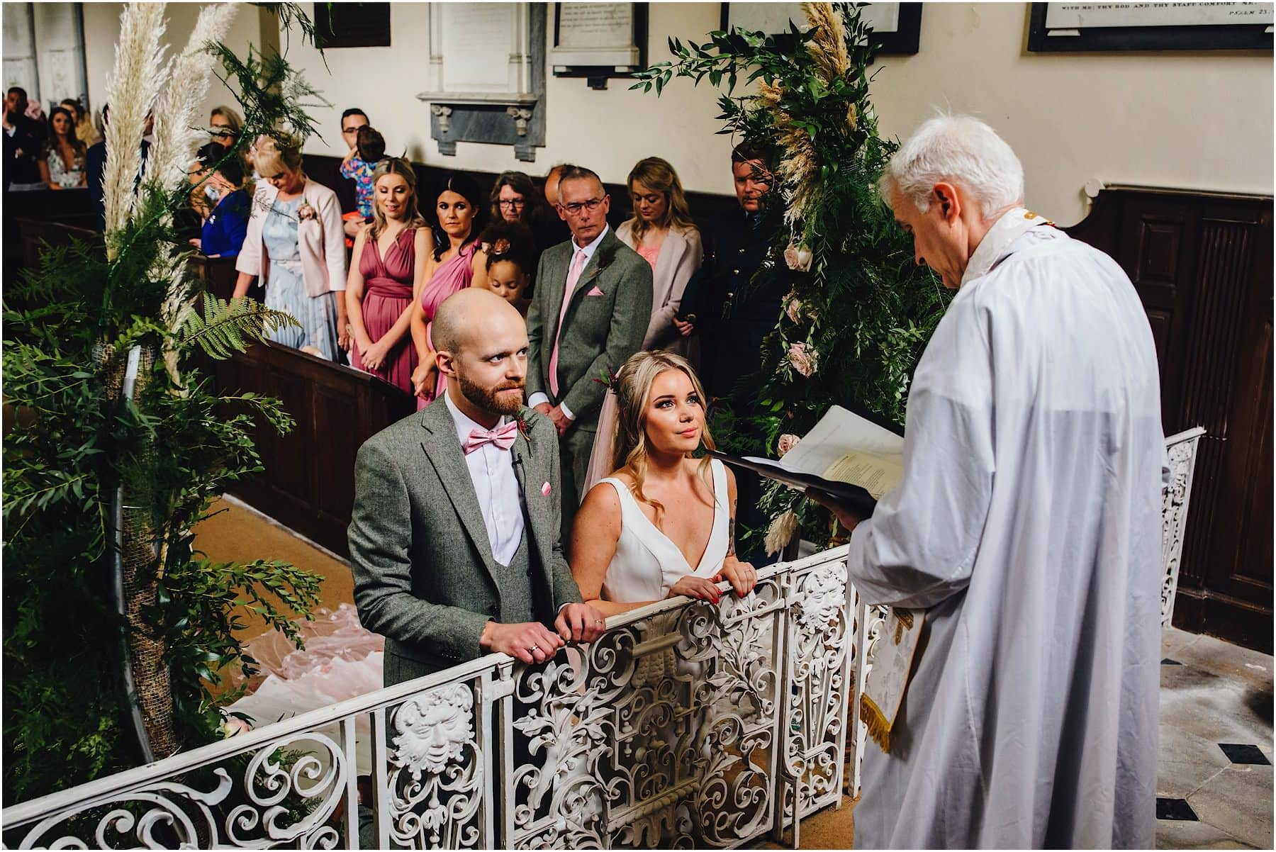 bride and groom on their knees in a church