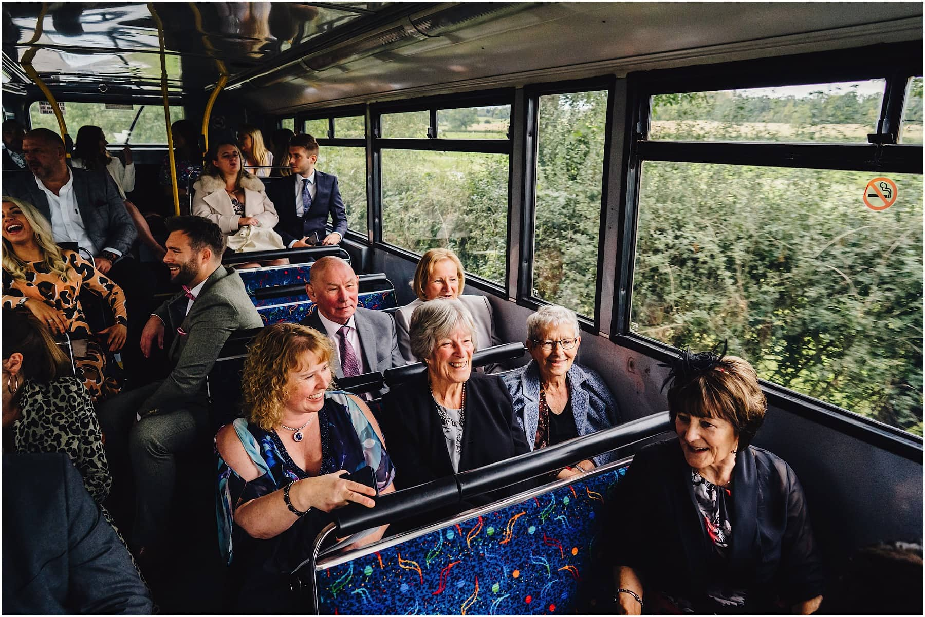 wedding guests on a bus leaving the church