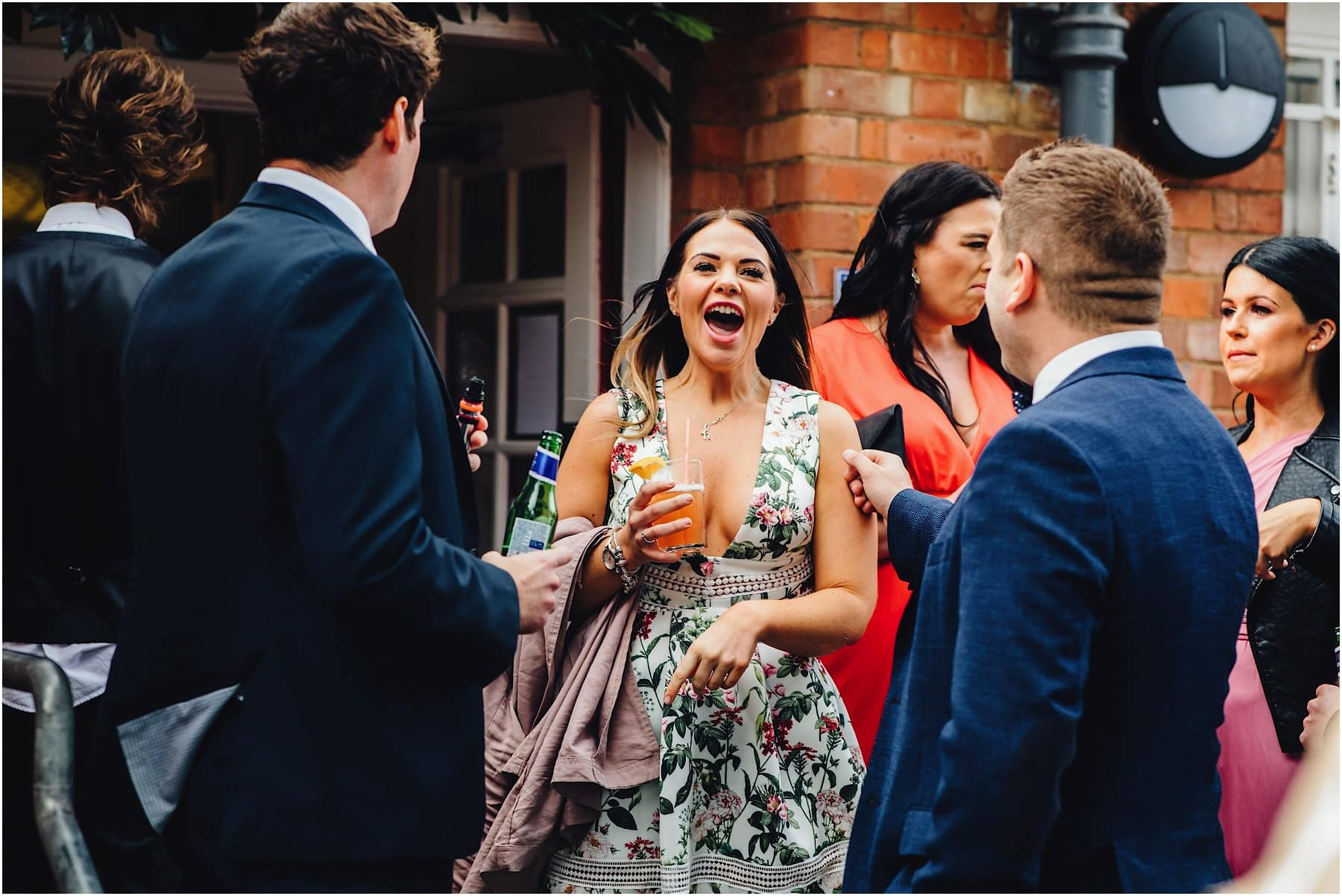 wedding guests having a drink