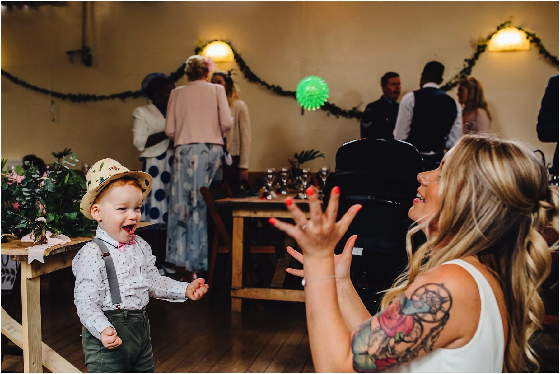 bride playing catch with her young son
