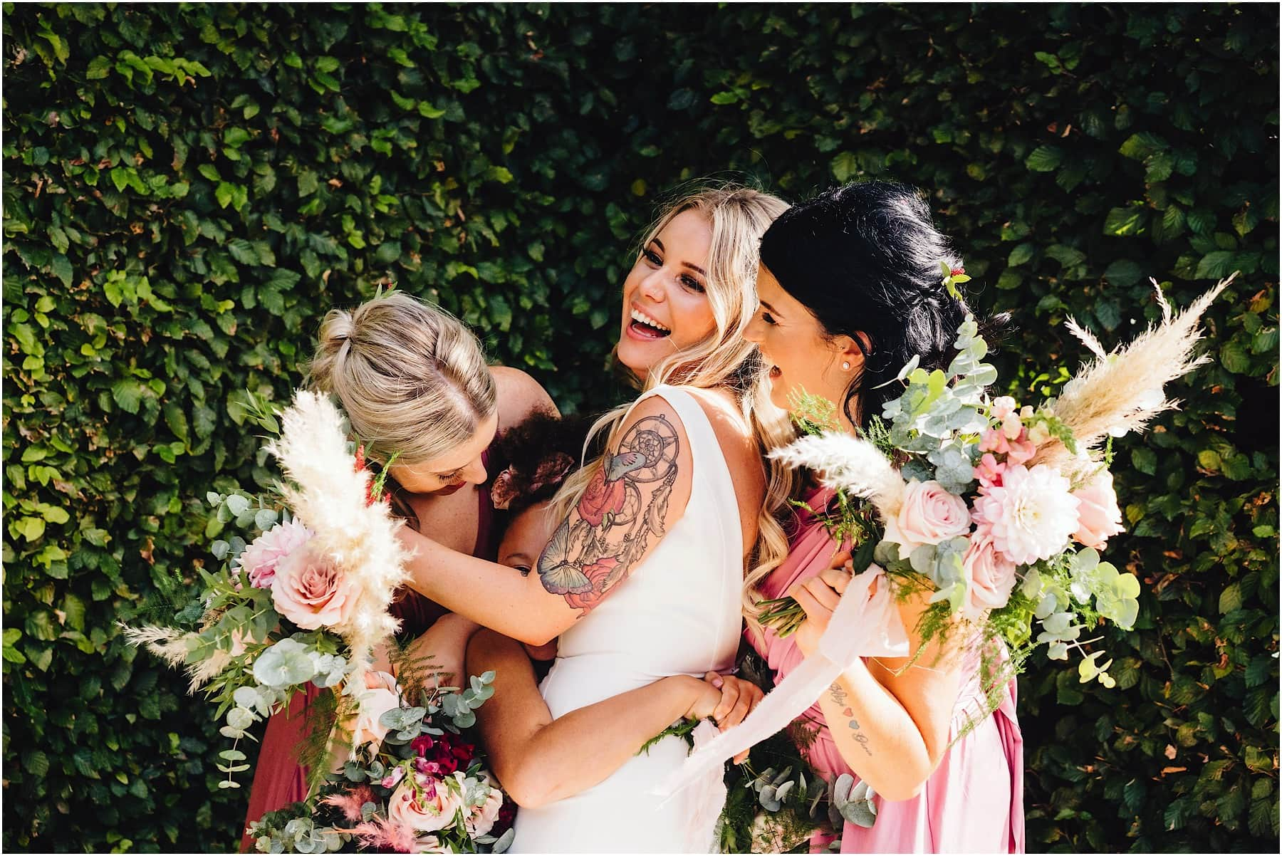 bride and bridesmaids hugging