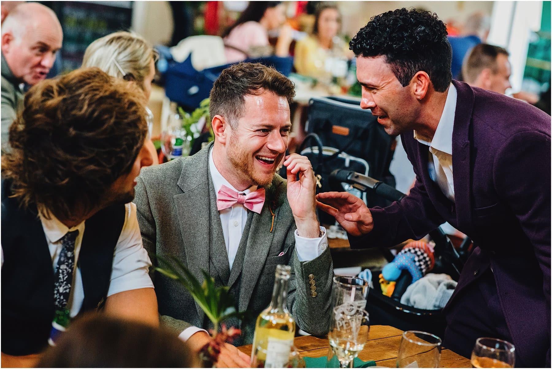 groomsmen laughing at joke