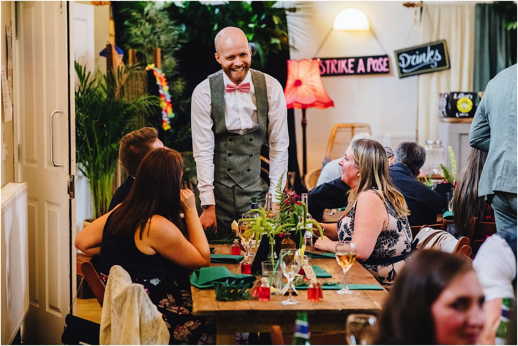 groom laughing and joking at with guests