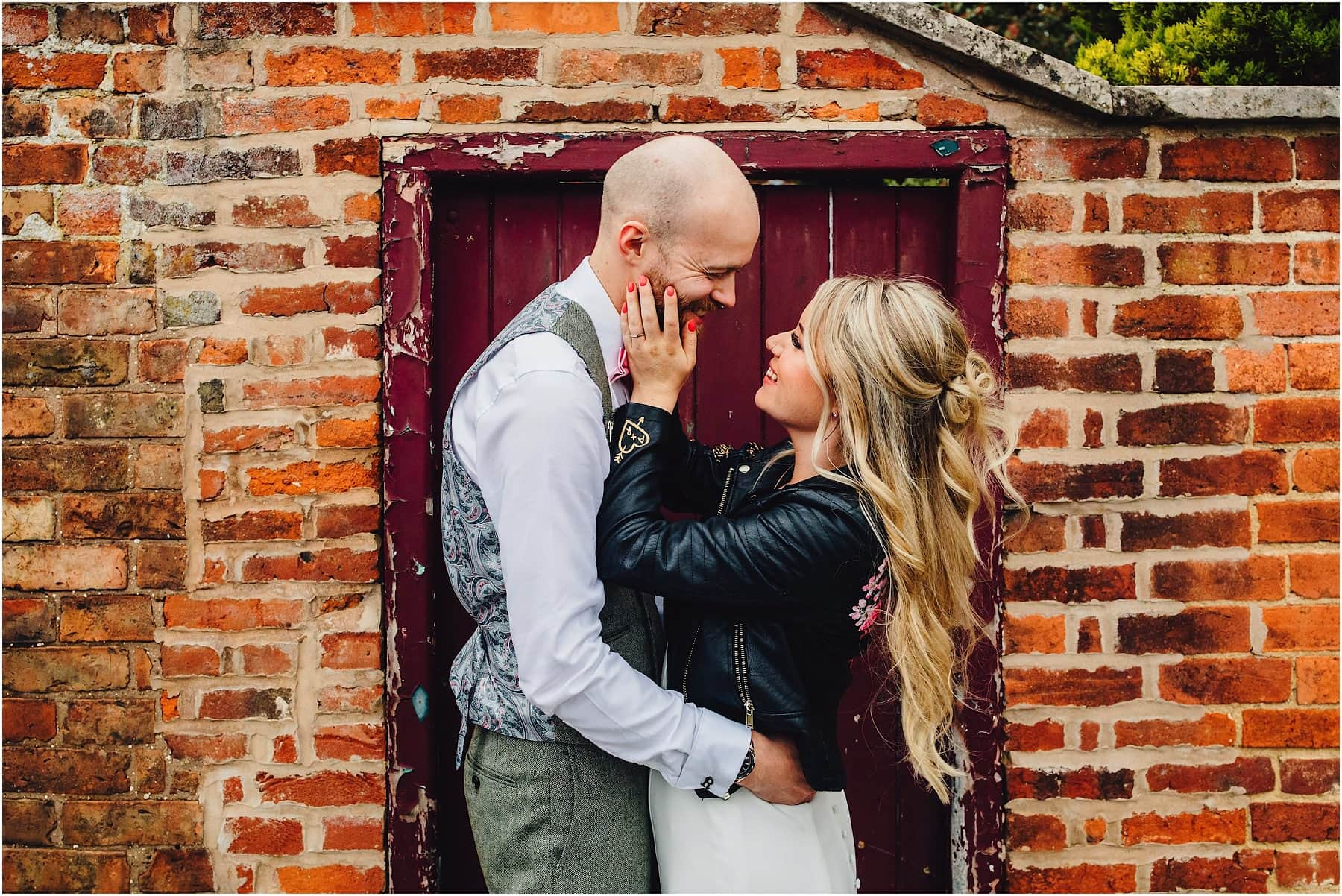 bride touching grooms face