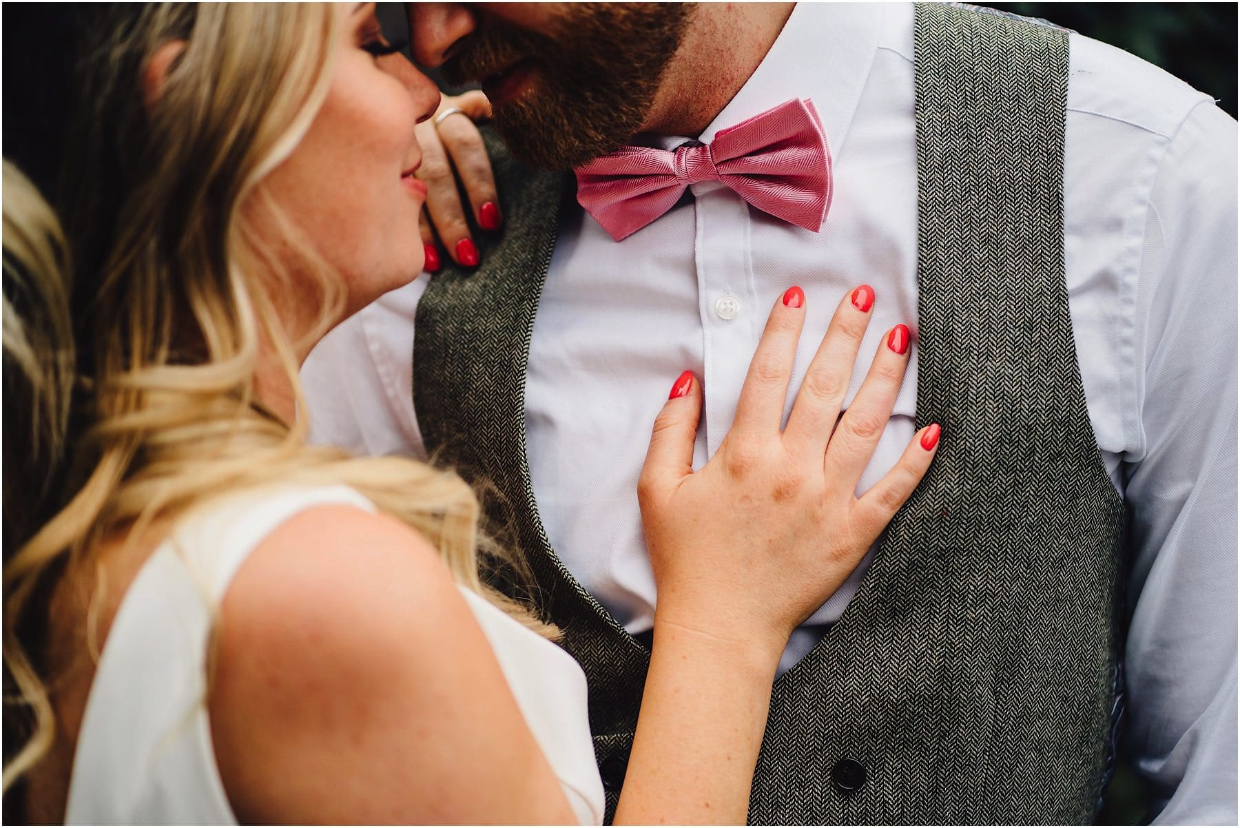 bride resting hand on grooms chest