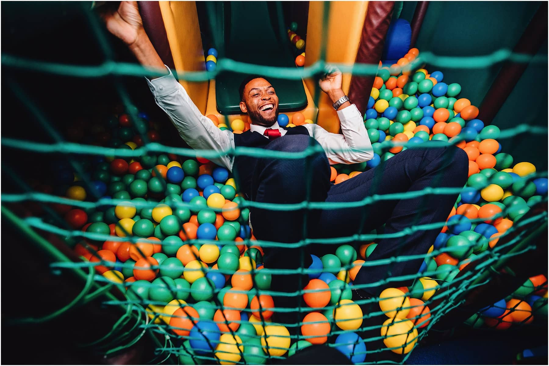 wedding guest in ball pit