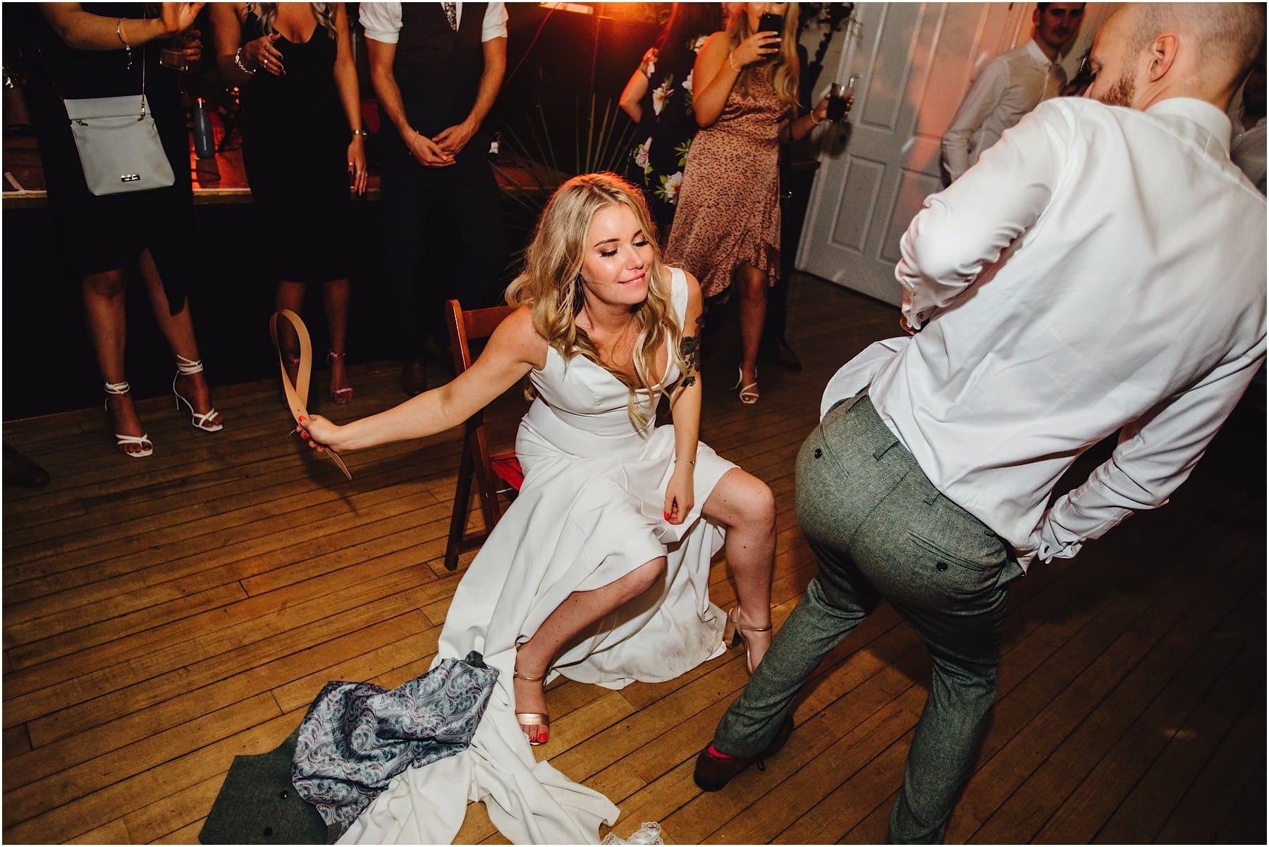 bride having fun with groom on the dance floor