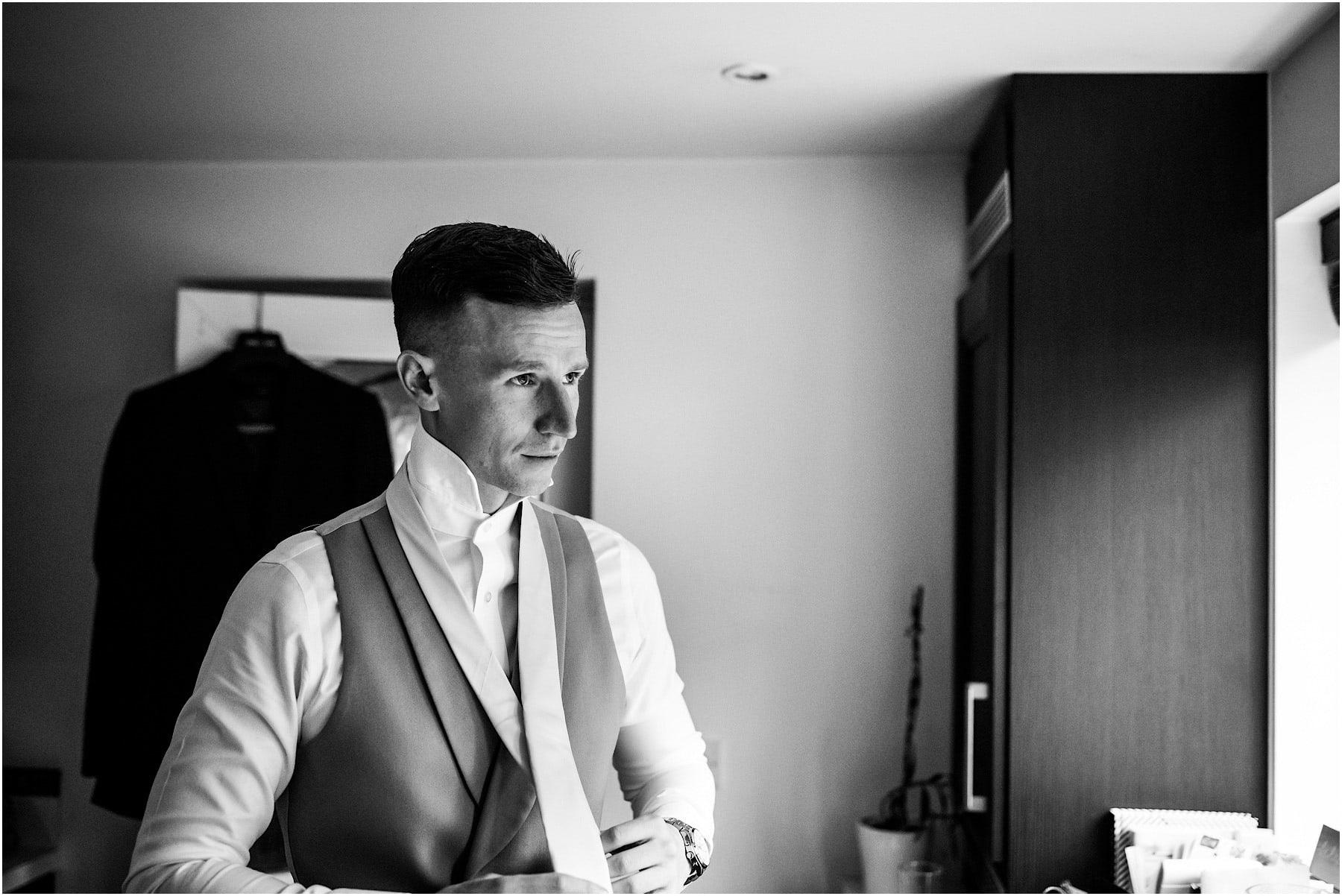 groom doing up his tie